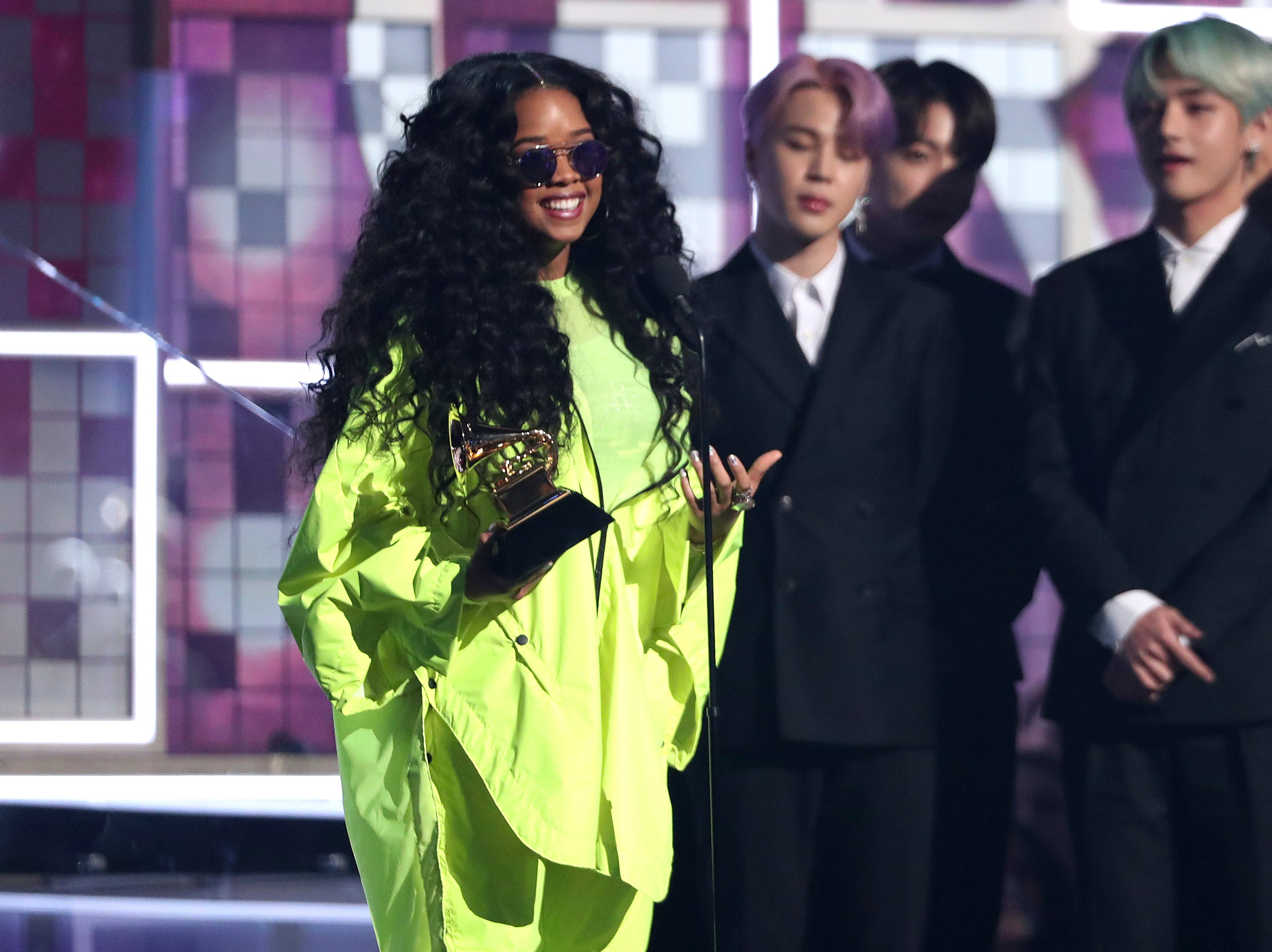 "H.E.R. accepts the award for best R&B album for ""H.E.R."" at the 61st annual Grammy Awards."