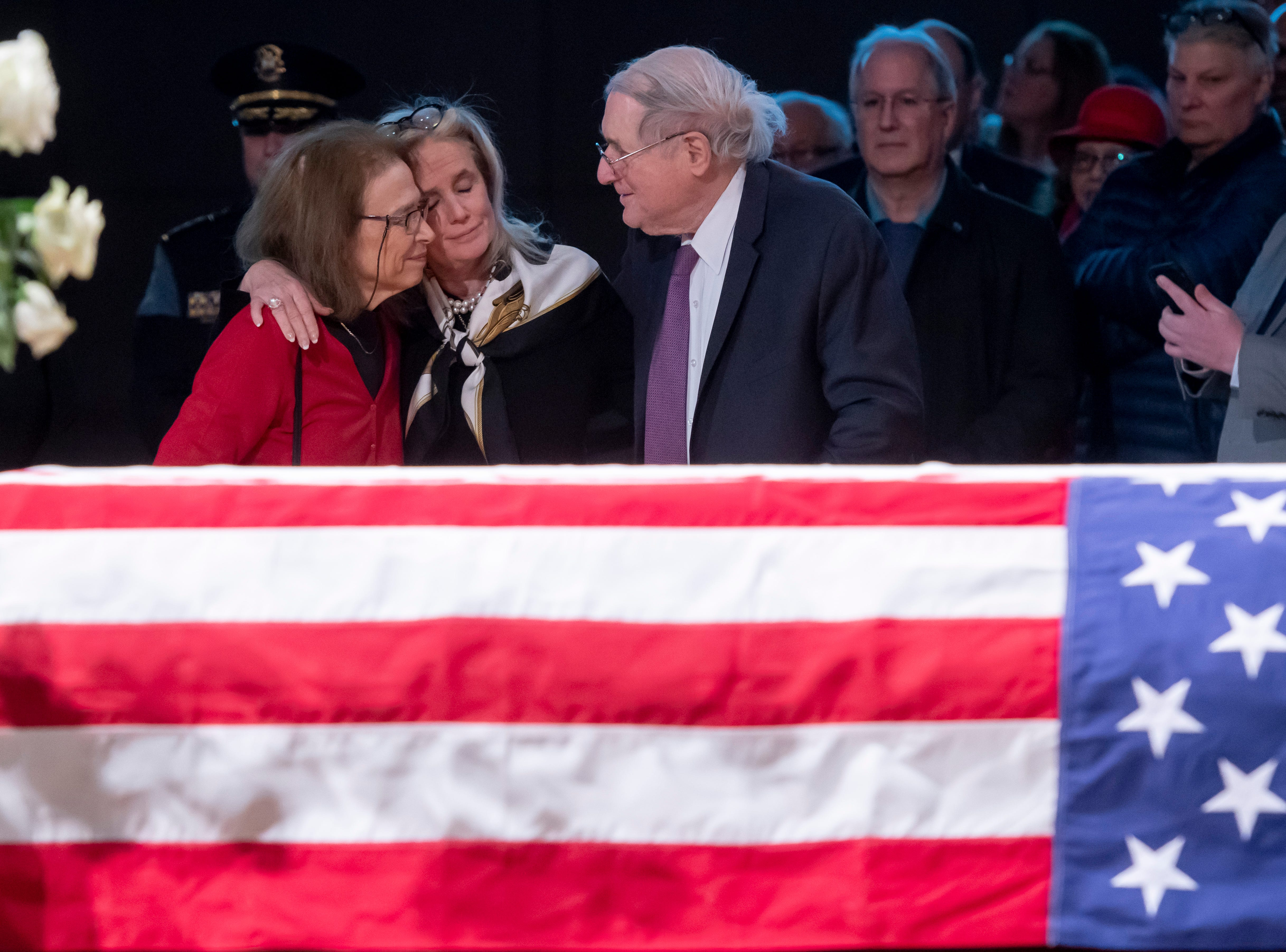 U.S. Representative Debbie Dingell, center, receives condolences from former U.S. Senator Carl Levin, right, and his wife Barbara during the visitation.