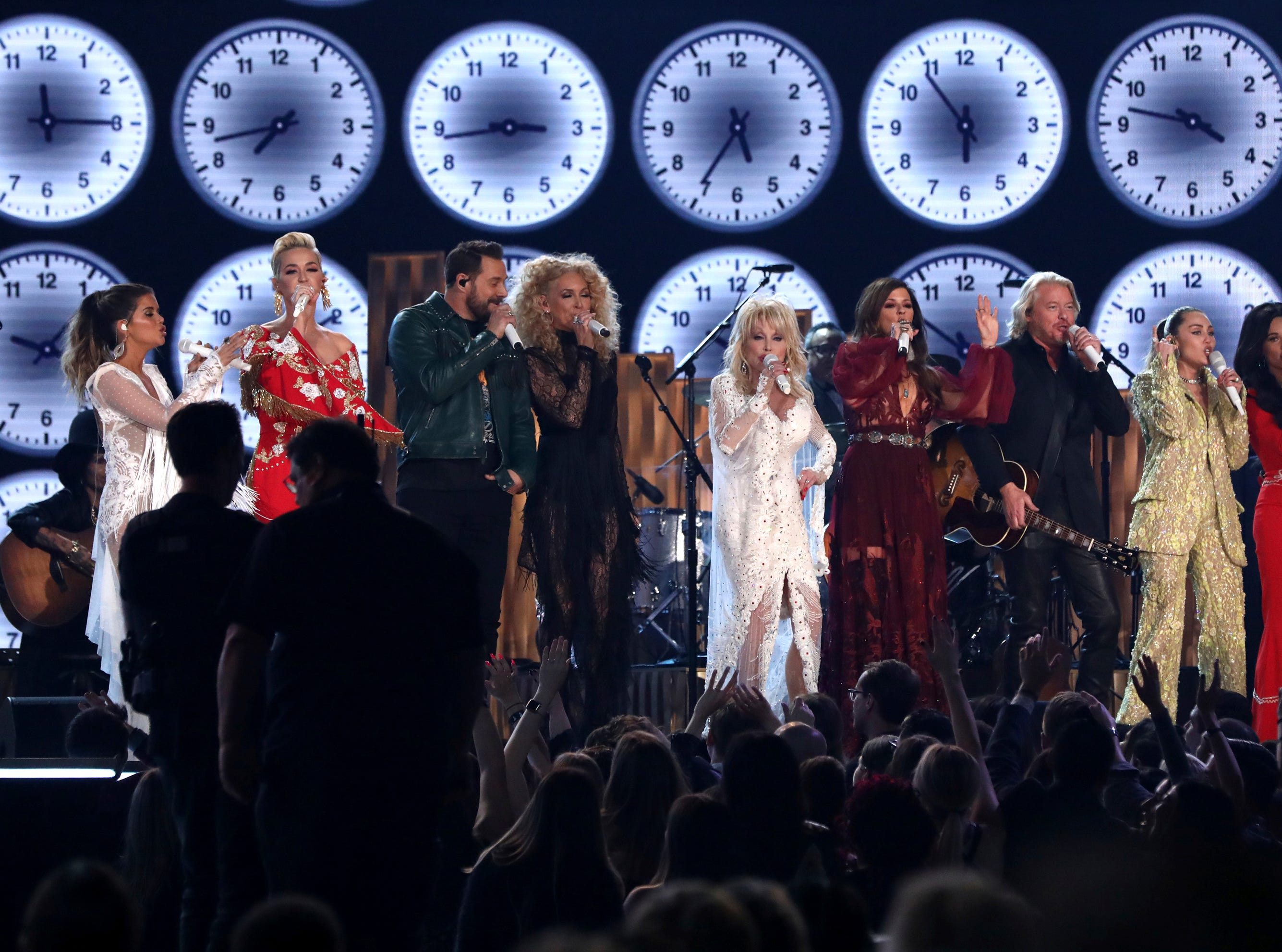 "Maren Morris, from left, Katy Perry, Jimi Westbrook, Kimberly Schlapman, Dolly Parton, Karen Fairchild, Philip Sweet, Miley Cyrus and Kacey Musgraves perform ""9 to 5"" at the 61st annual Grammy Awards."