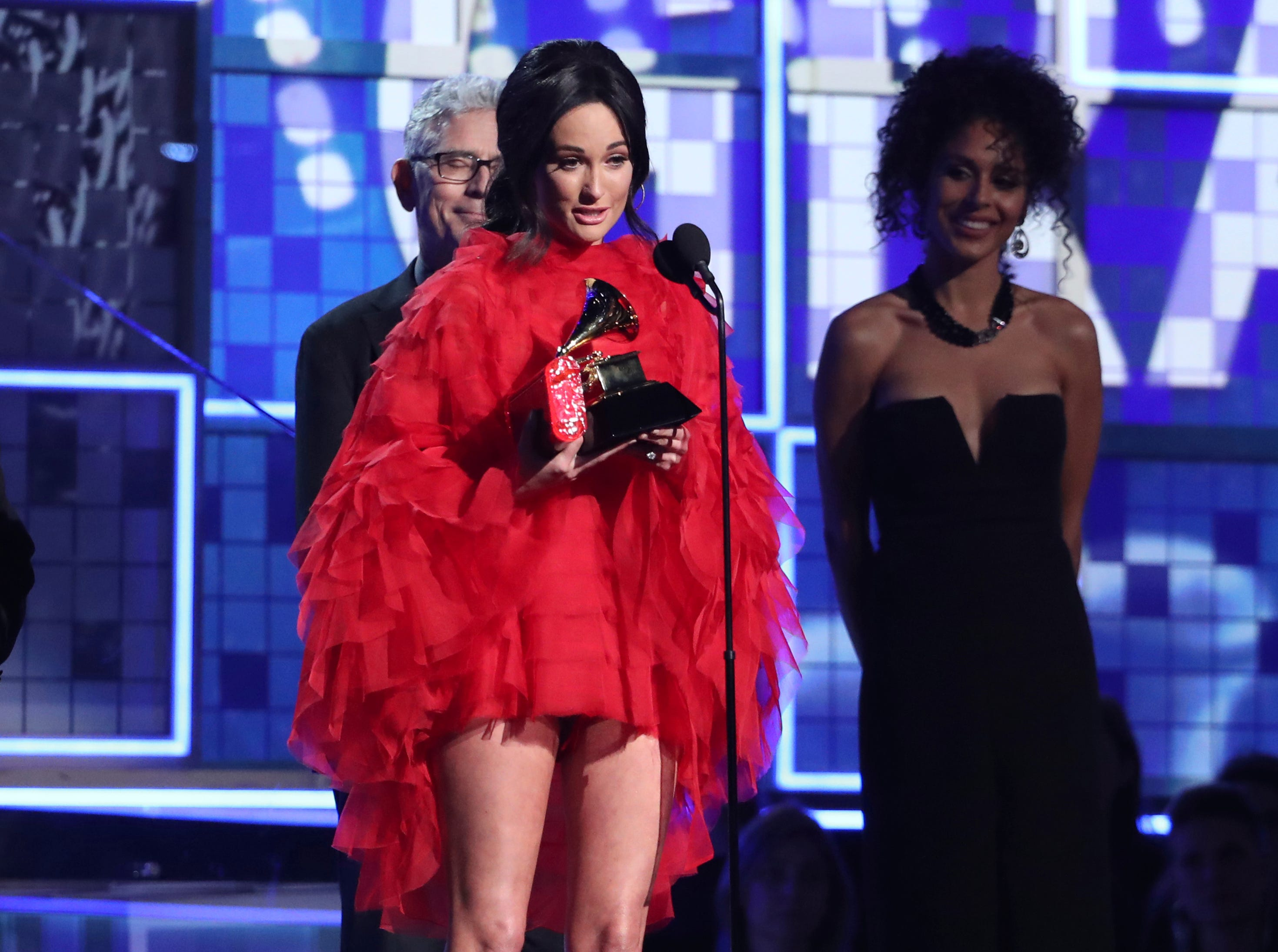 "Kacey Musgraves accepts the award for album of the year for ""Golden Hour"" at the 61st annual Grammy Awards on Sunday, Feb. 10, 2019, in Los Angeles."