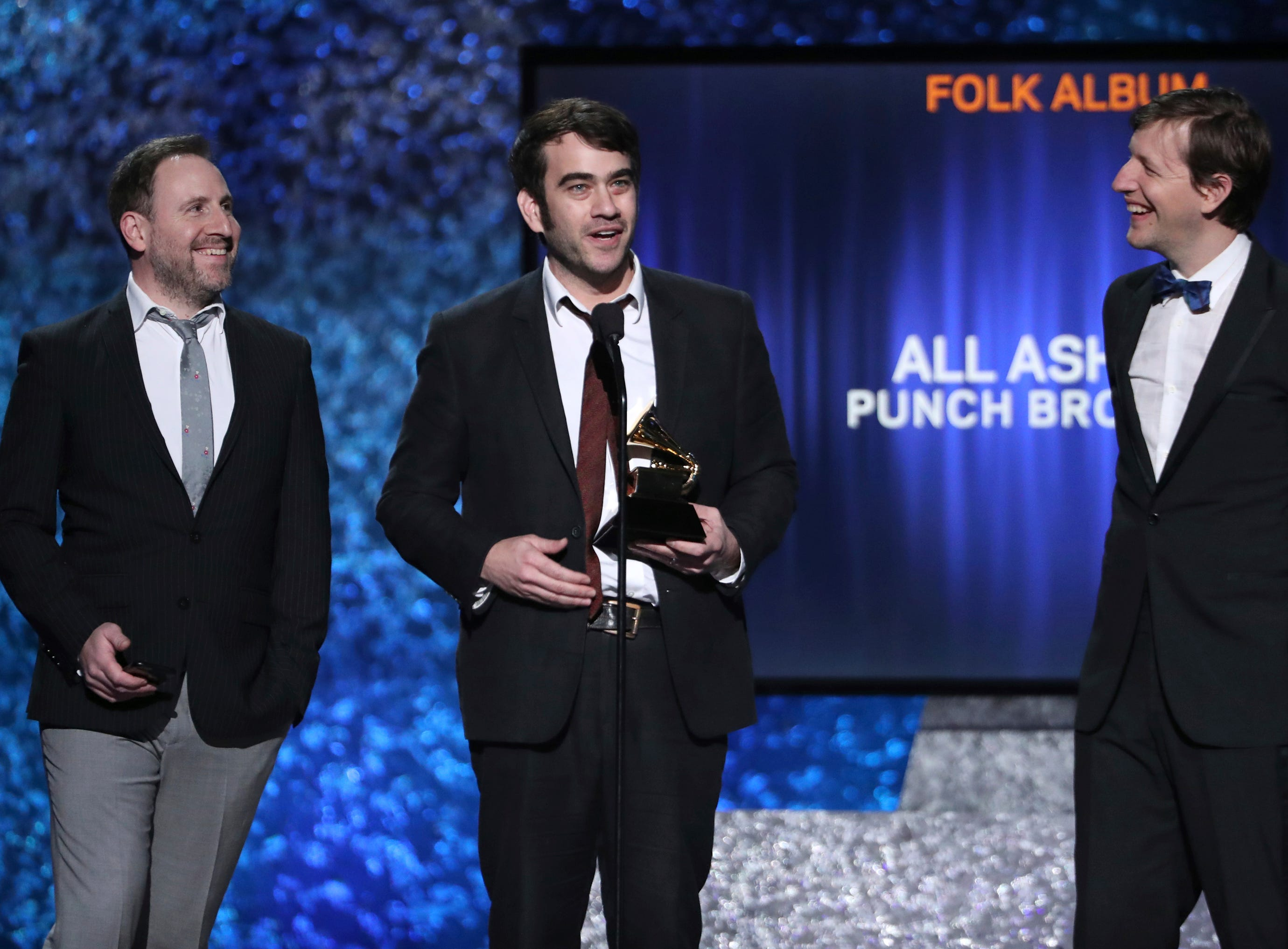 "Gabe Witcher, from left, Noam Pikelny and Chris Eldridge of ""The Punch Brothers"" accept the award for best folk album for ""All Ashore"" at the 61st annual Grammy Awards."