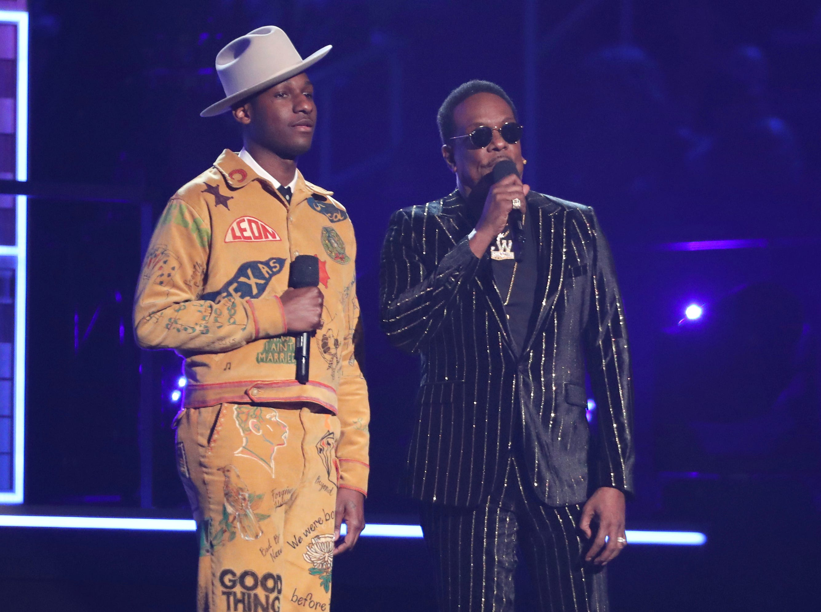 Leon Bridges, left, and Charlie Wilson introduce a performance at the 61st annual Grammy Awards.