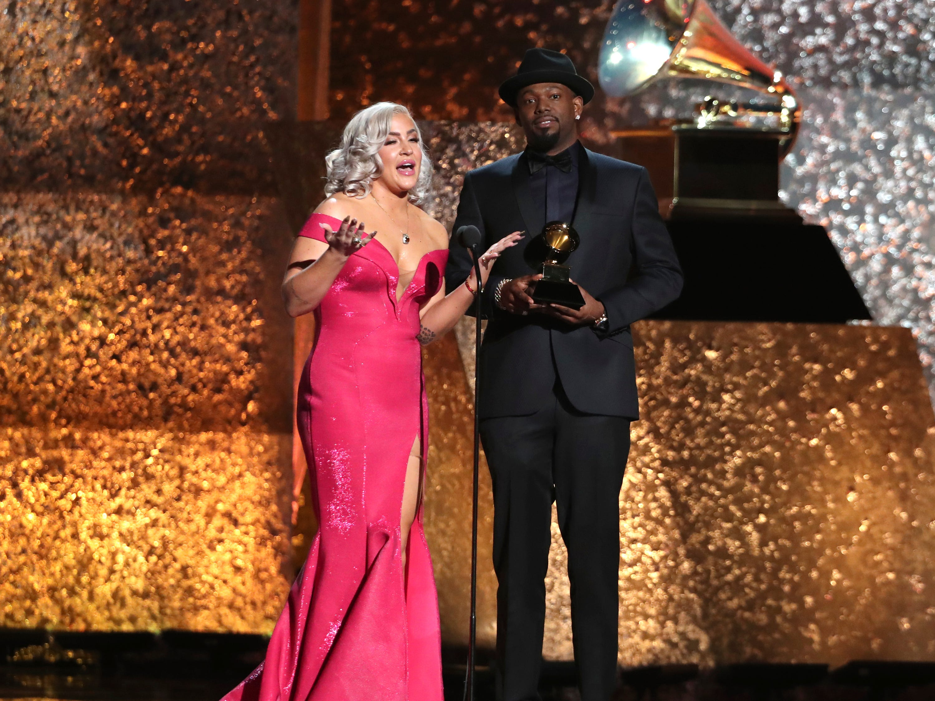 "Joelle James, left, and Larrance Dopson accept the award for best r&b song for ""Boo'd Up"" at the 61st annual Grammy Awards."