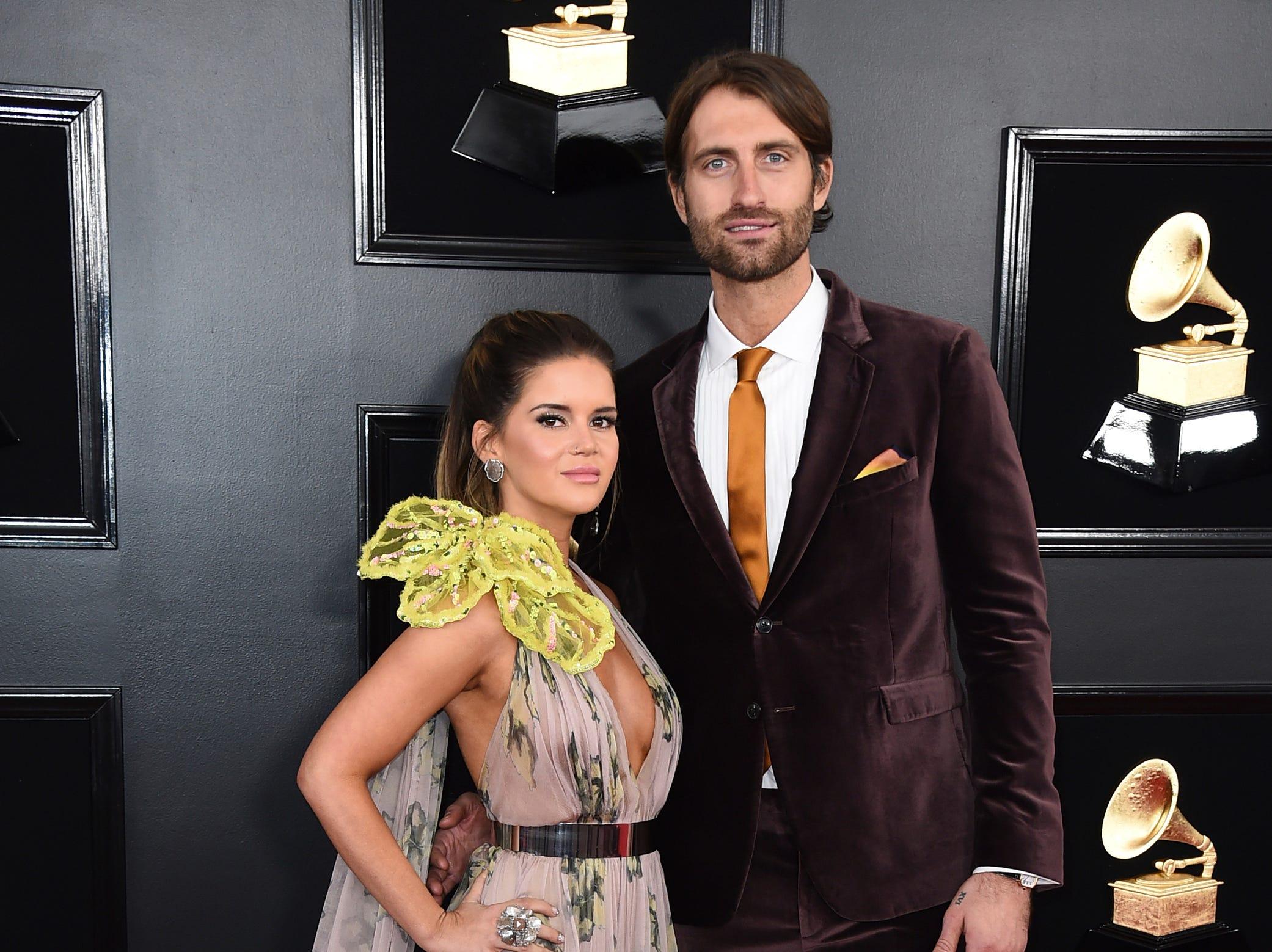 Maren Morris, left, and Ryan Hurd arrive at the 61st annual Grammy Awards.
