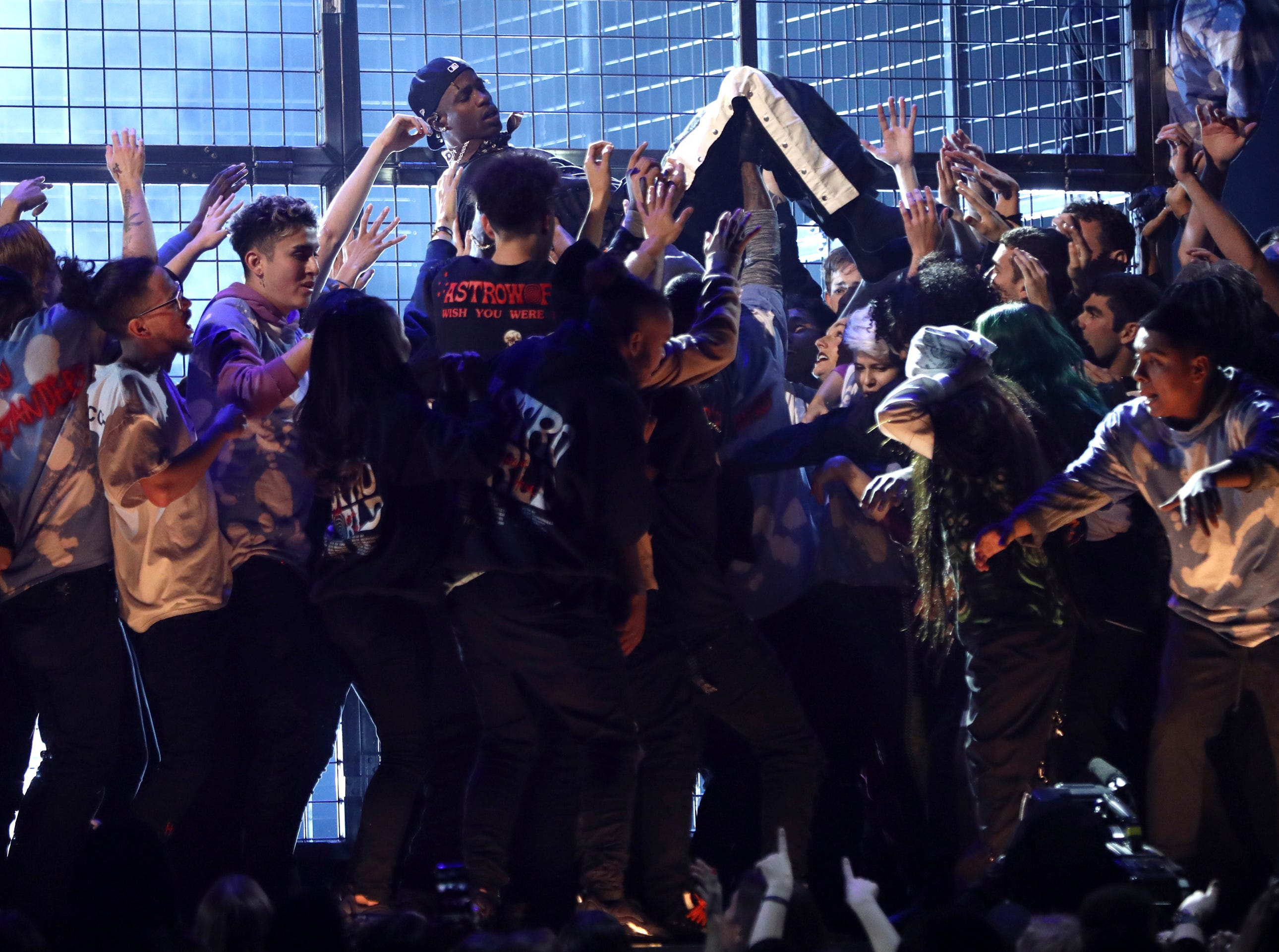 Travis Scott is carried during a performance at the 61st annual Grammy Awards.