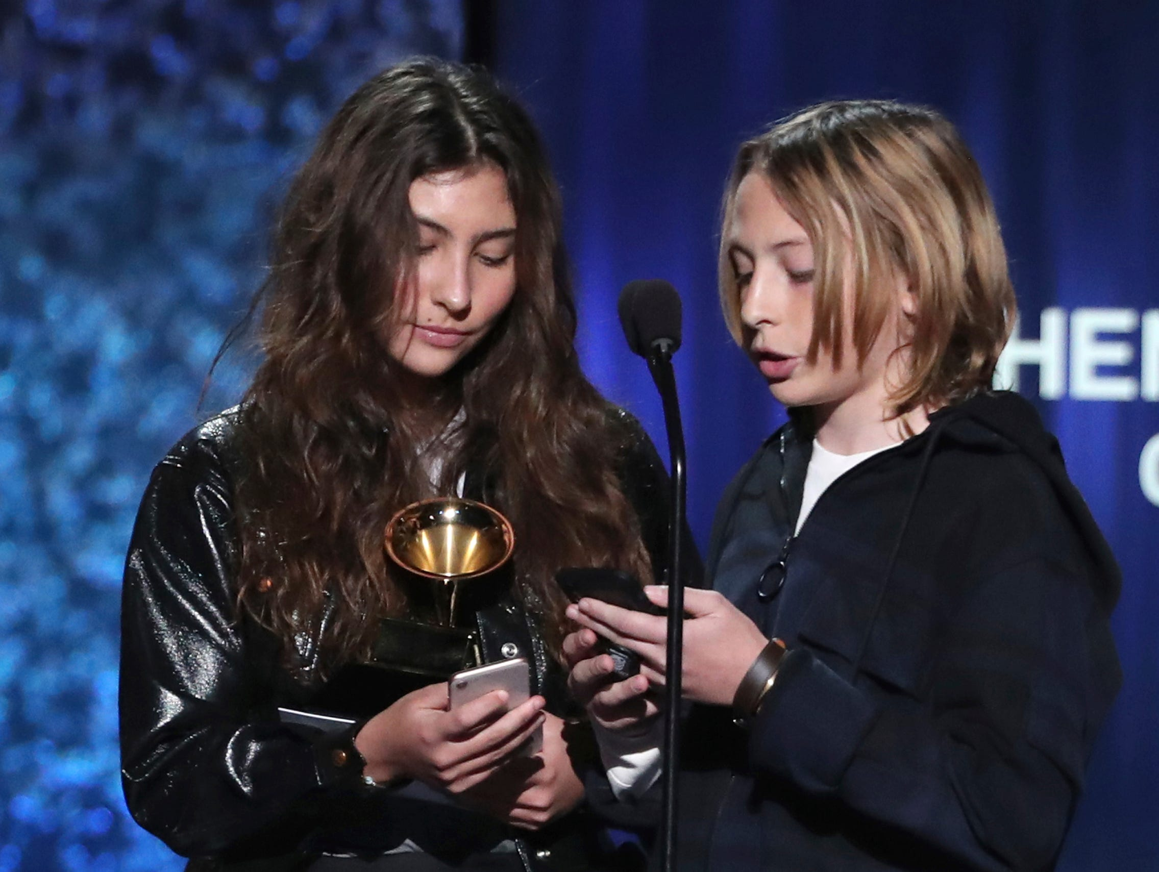 "Toni Cornell, left, and Christopher Nicholas Cornell accept the award for best rock performance for ""When Bad Does Good"" on behalf of their late father Chris Cornell at the 61st annual Grammy Awards."