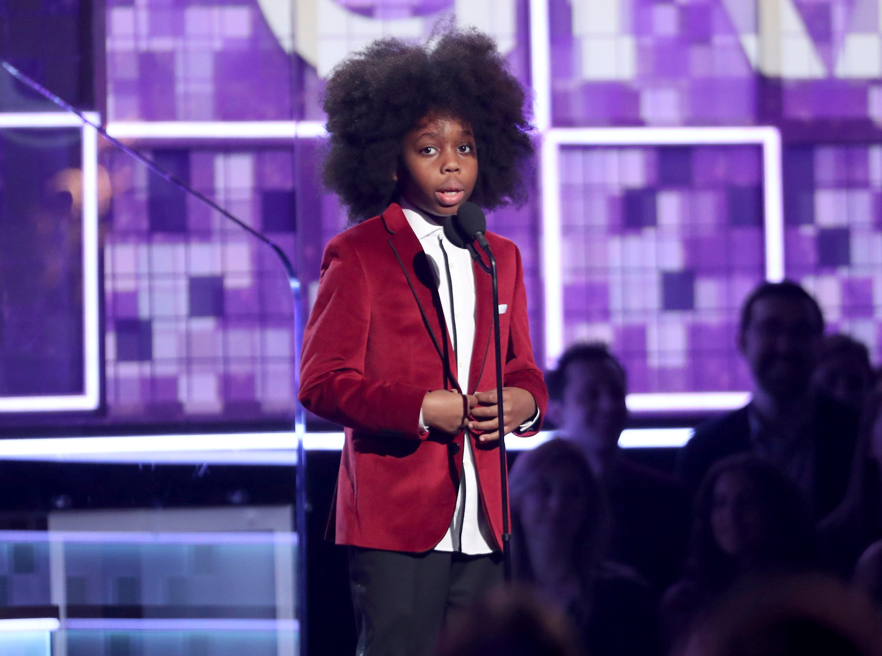 Raif-Henok Emmanuel Kendrick introduces a performance by grandmother Diana Ross at the 61st annual Grammy Awards.