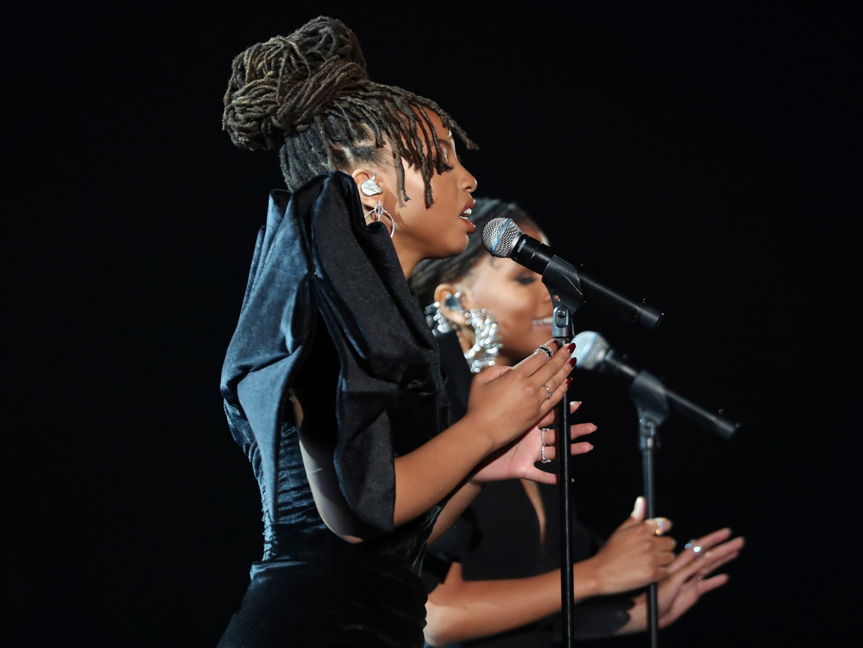 "Halle Bailey, foreground, and Chloe Bailey, of Chloe x Halle, perform ""Where Is The Love"" at the 61st annual Grammy Awards."
