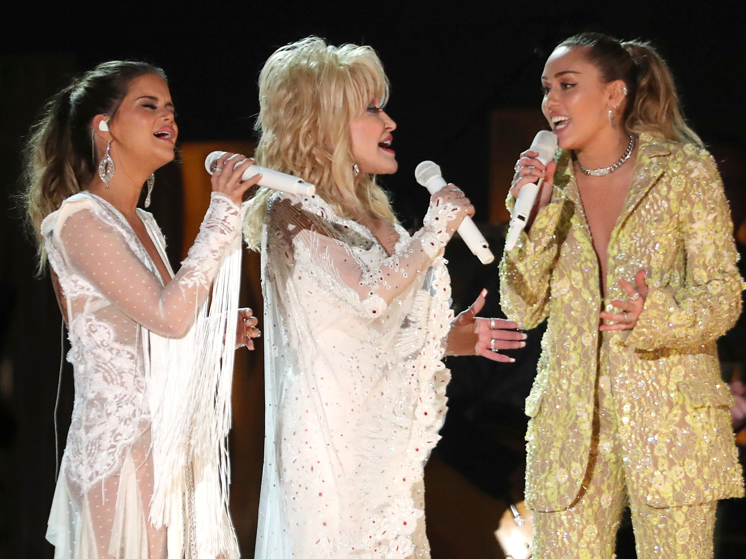 "Maren Morris, from left, Dolly Parton and Miley Cyrus perform ""After The Goldrush"" at the 61st annual Grammy Awards."