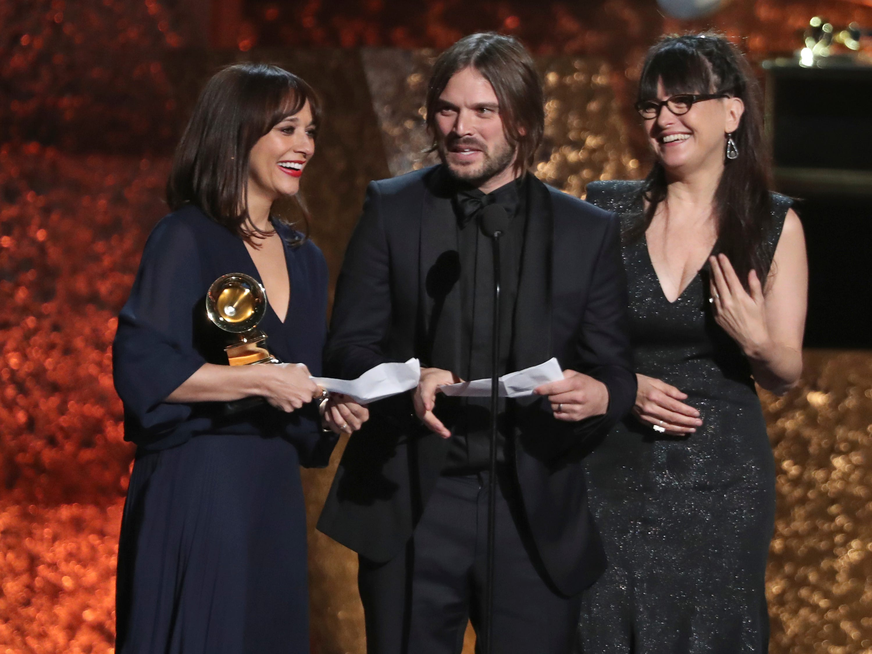 "Rashida Jones, from left, Alan Hicks and Paula DuPre Pesmen accept the award for best music film for ""Quincy"" at the 61st annual Grammy Awards."