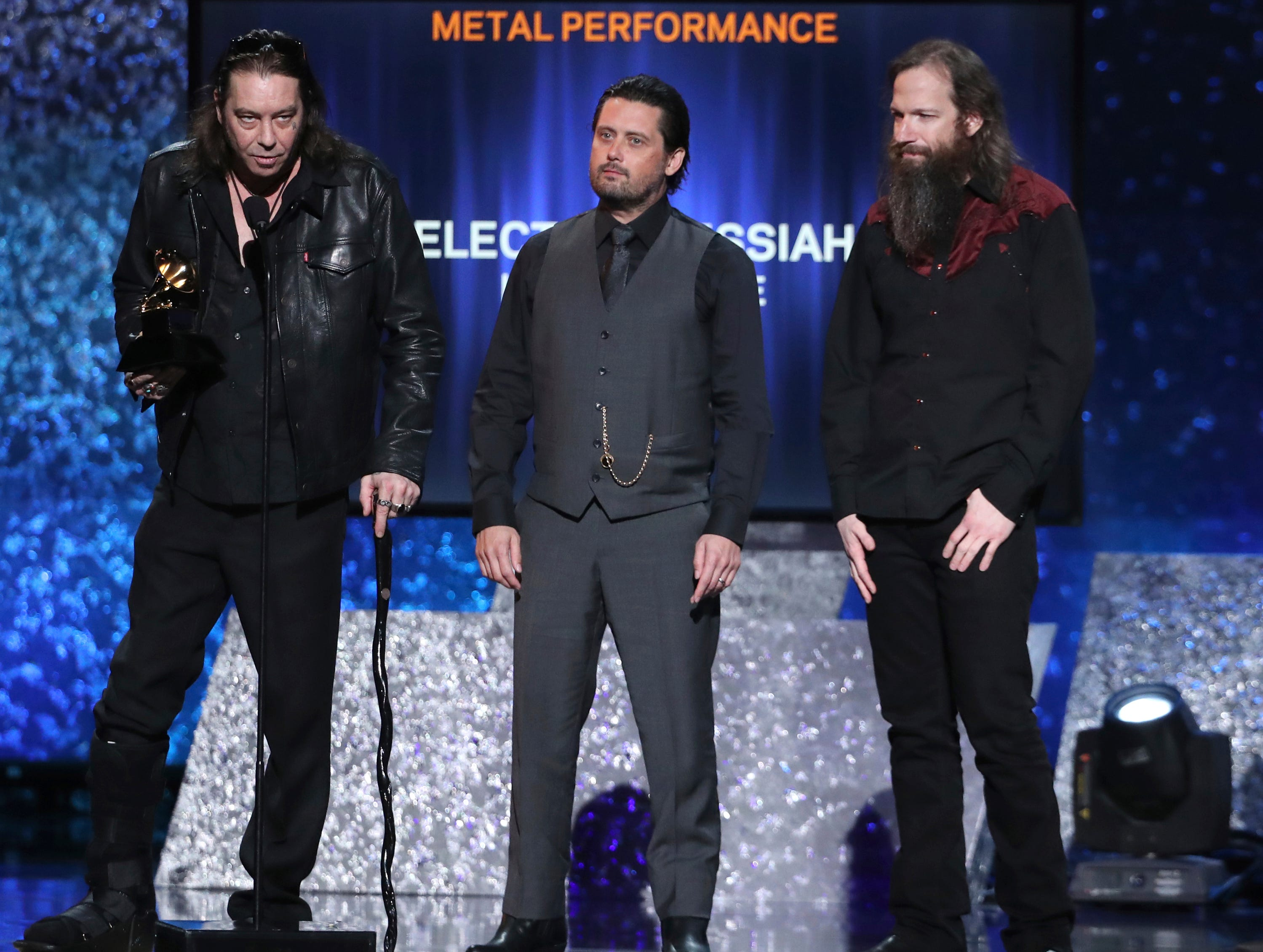"Matt Pike, from left, Des Kensel and Jeff Matz, of Electric Messiah, accept the award for best metal performance for ""High On Fire"" at the 61st annual Grammy Awards."