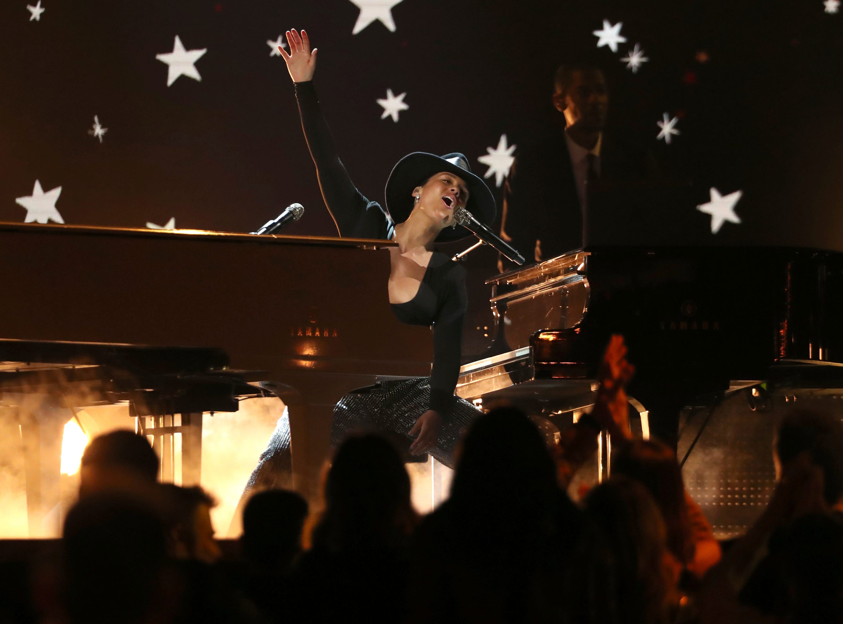 Host Alicia Keys performs a medley at the 61st annual Grammy Awards.