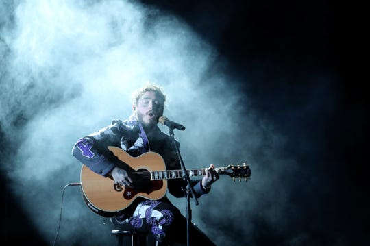 Post Malone performs a medley at the 61st annual Grammy Awards.
