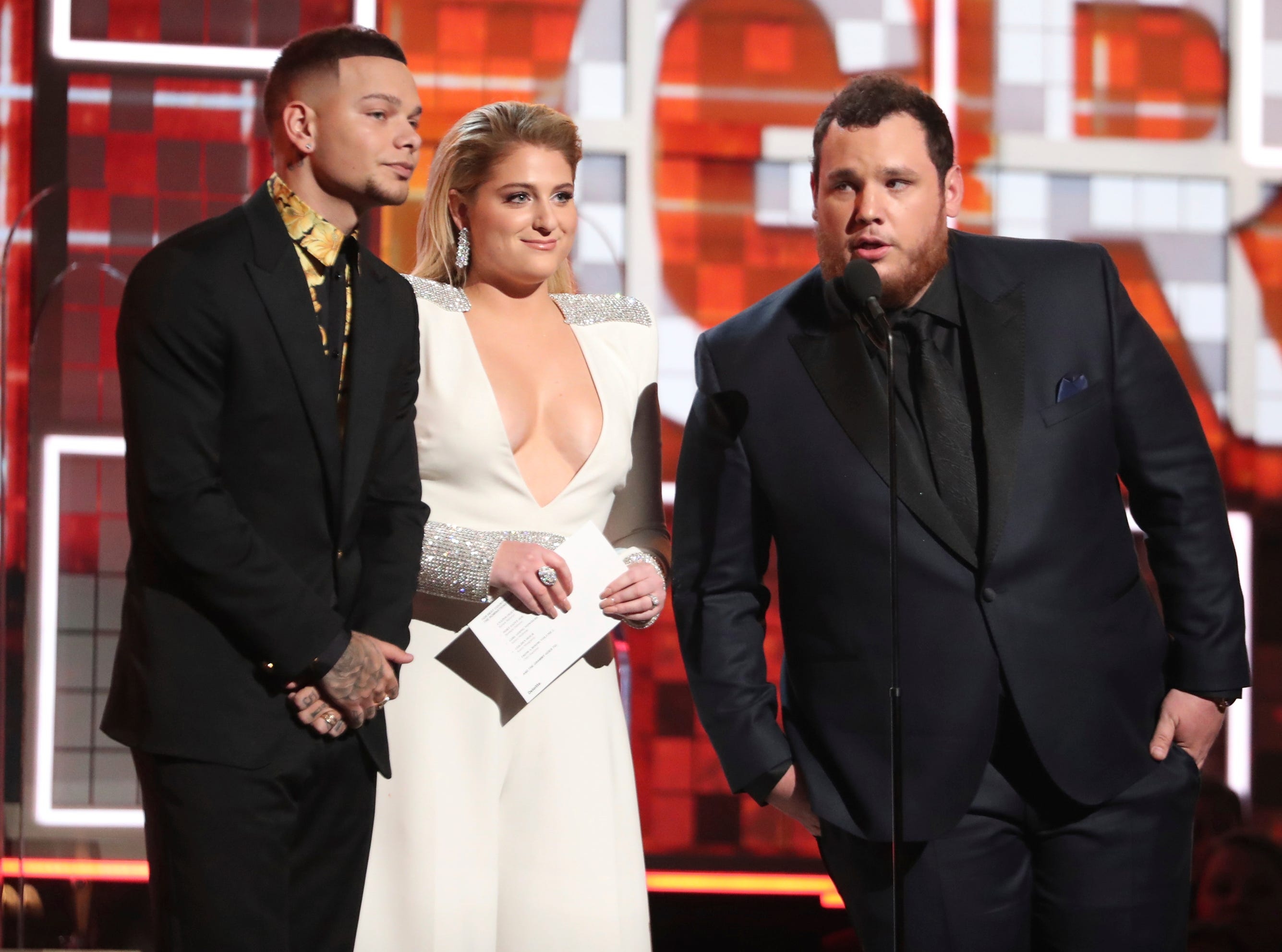 Kane Brown, from left, Meghan Trainor and Luke Combs present the award for best country album.