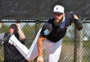 Tigers pitcher Michael Fulmer, shown here in spring training last season, is wearing a brace on his right knee during workouts.