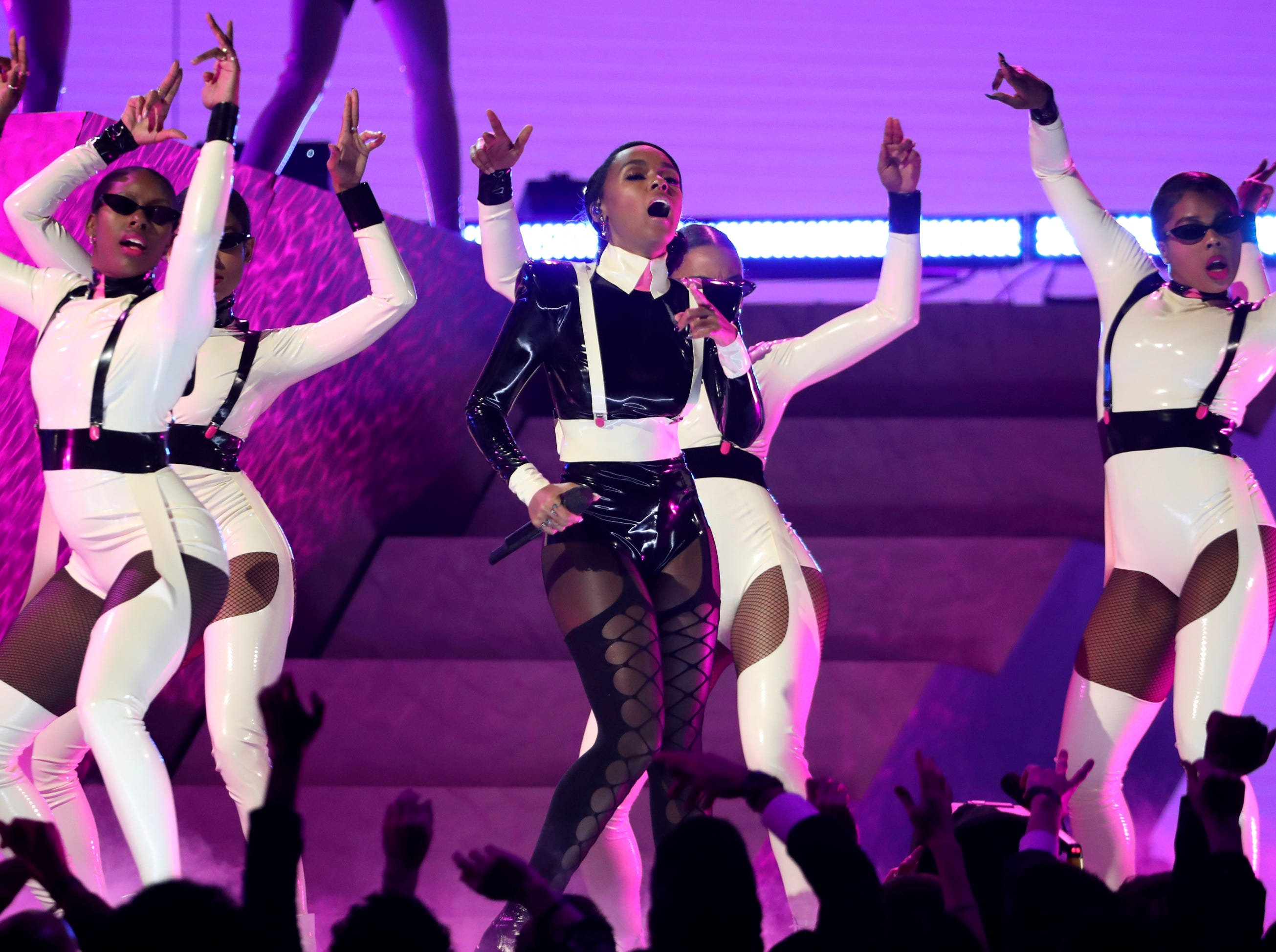 "Janelle Monae, center, performs ""Make Me Feel"" at the 61st annual Grammy Awards."