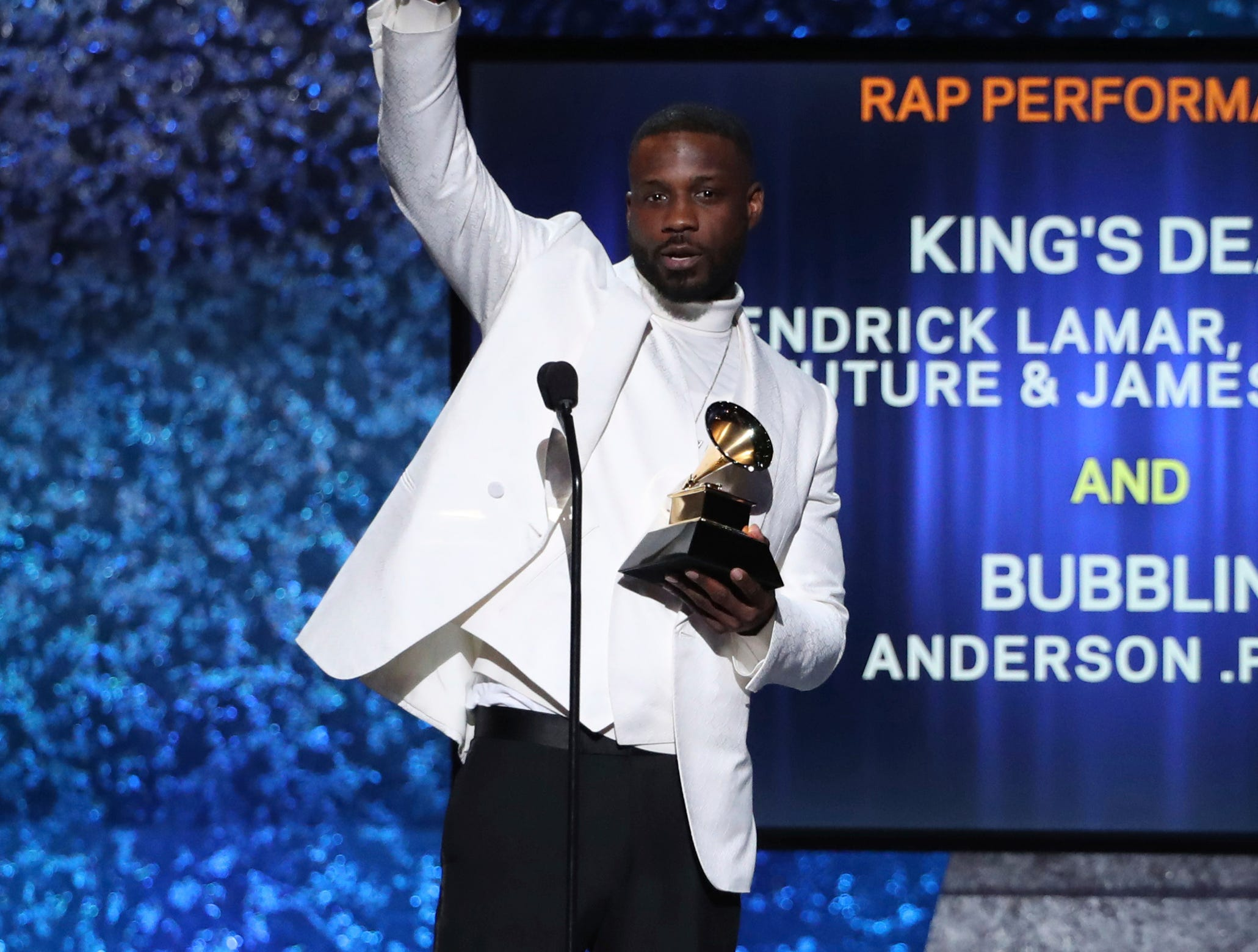 "Jay Rock accepts the award for best rap performance for ""King's Dead"" at the 61st annual Grammy Awards."