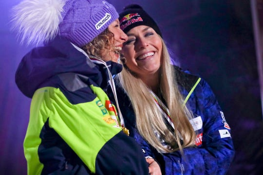 Winner Slovenia's Ilka Stuhec, left, and third placed United States' Lindsey Vonn share a laugh during the medal ceremony.