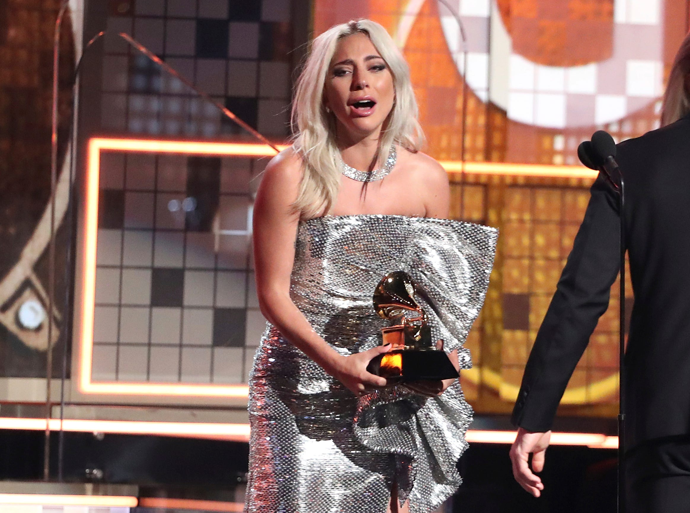"Lady Gaga reacts before accepting the award for best pop duo or group performance for ""Shallow"" at the 61st annual Grammy Awards."