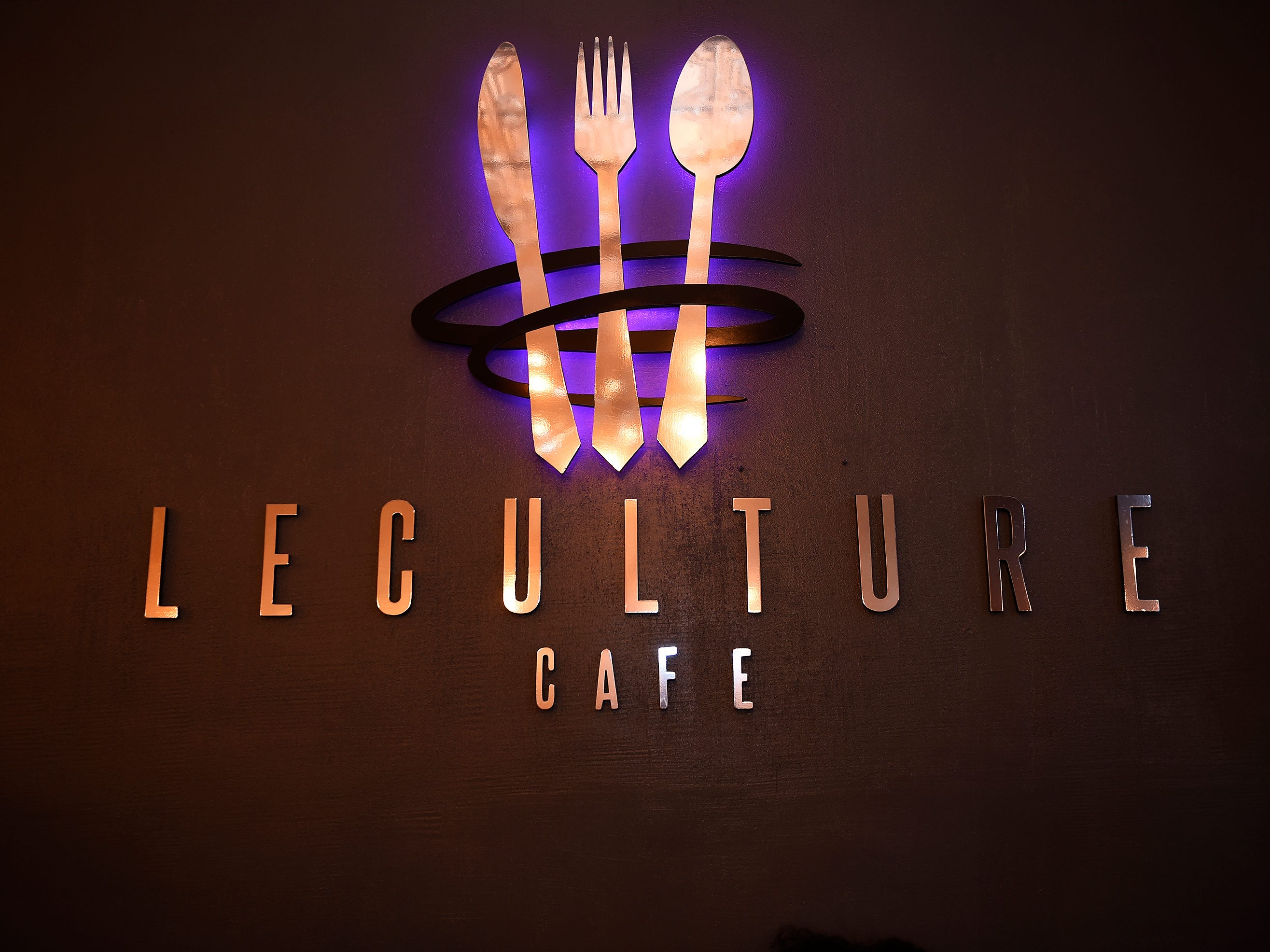 The restaurant logo is on the wall in dining area.