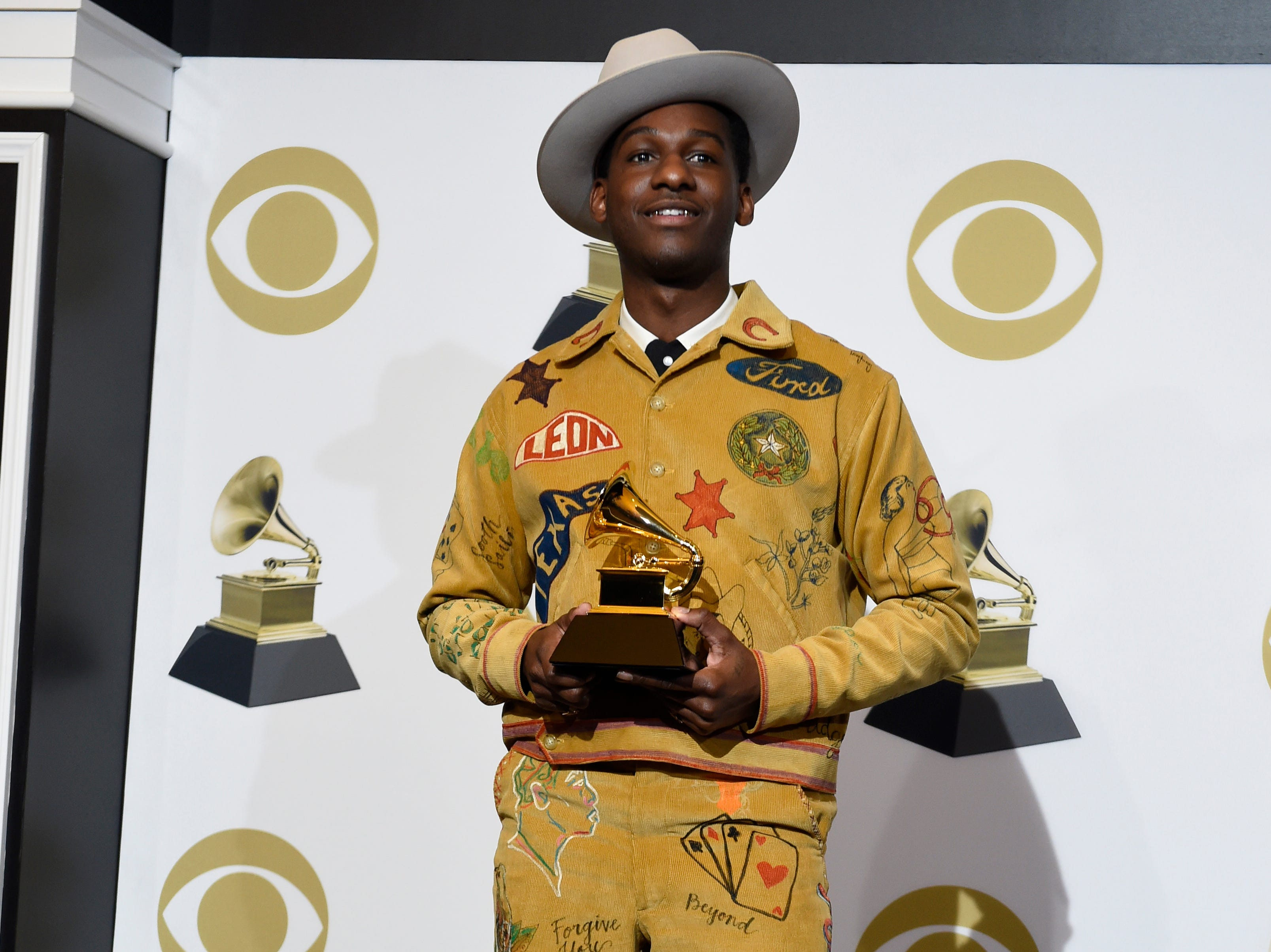 "Leon Bridges poses in the press room with the award for best traditional R&B performance for ""Bet Ain't Worth The Hand"" at the 61st annual Grammy Awards."