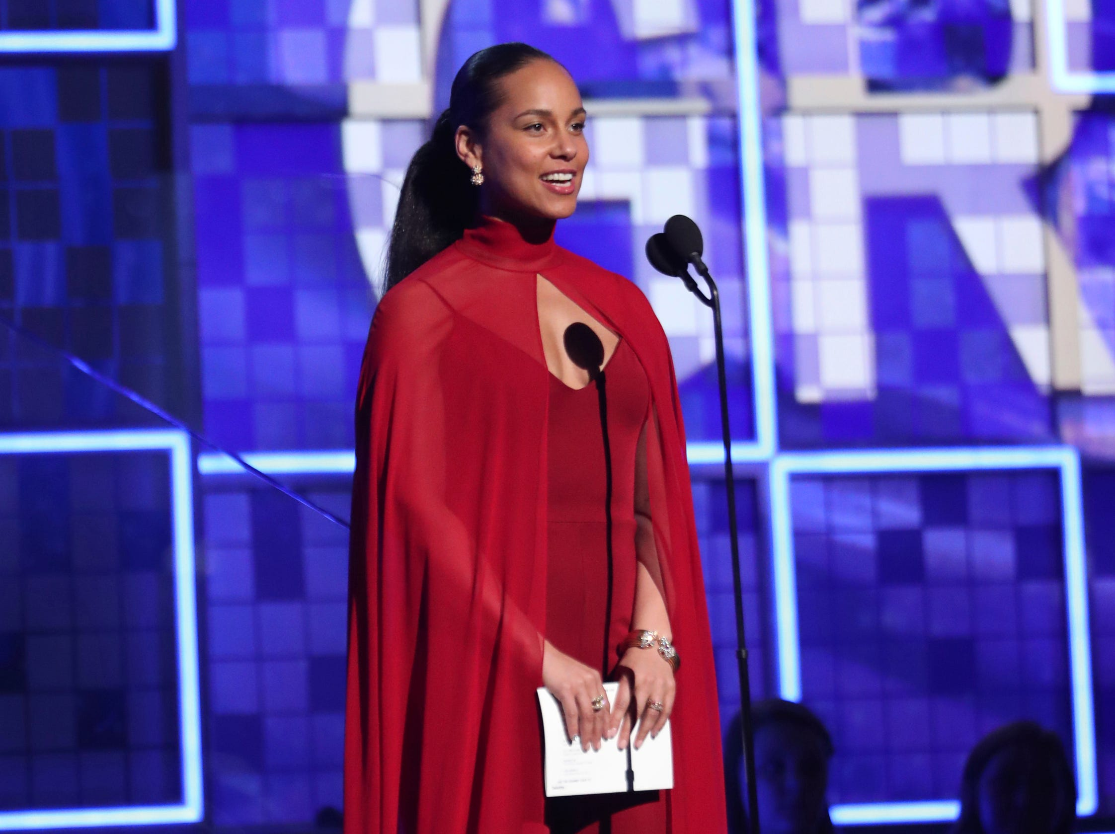 Alicia Keys presents the award for record of the year at the 61st annual Grammy Awards.