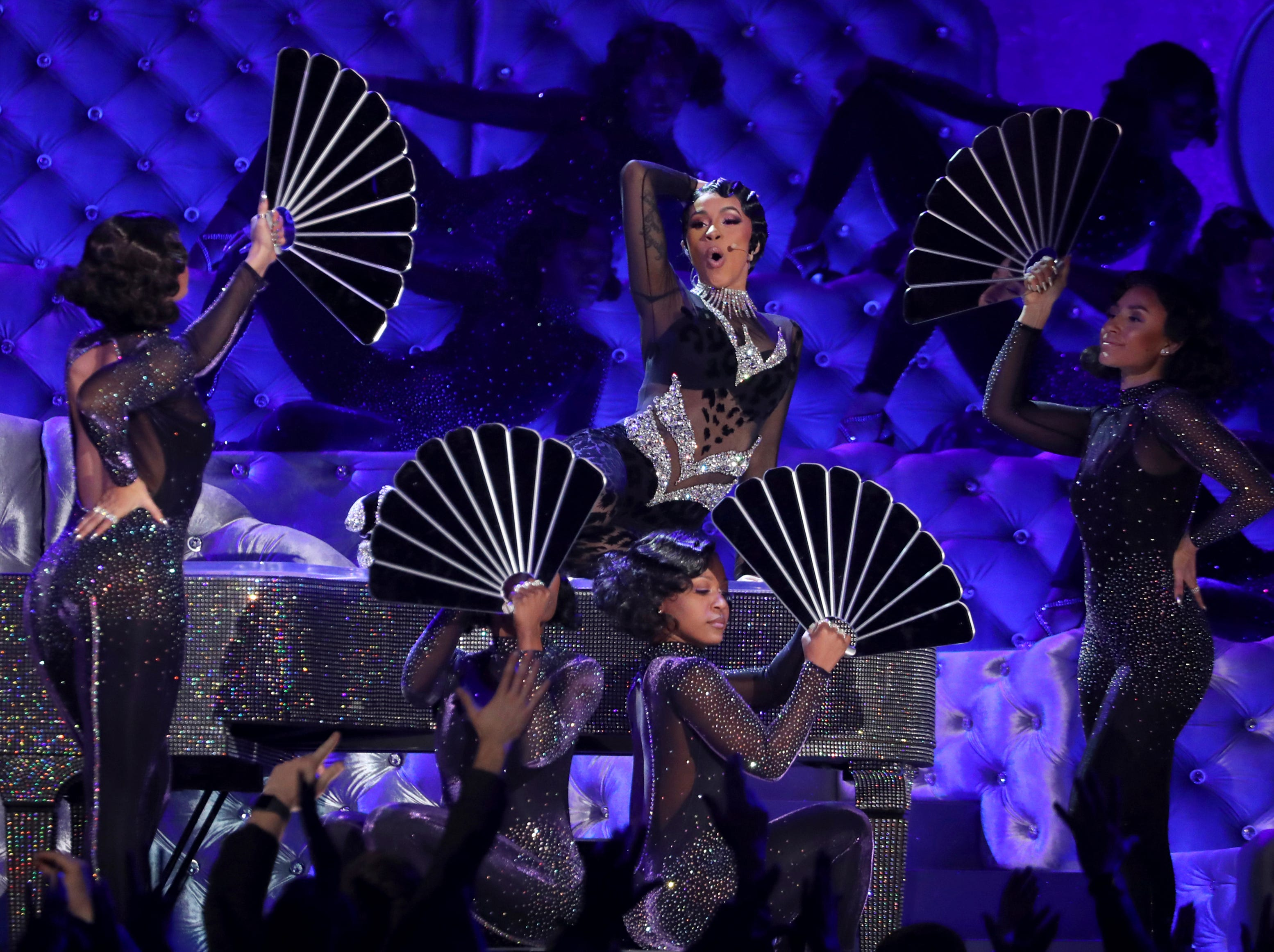 "Cardi B performs ""Money"" at the 61st annual Grammy Awards."
