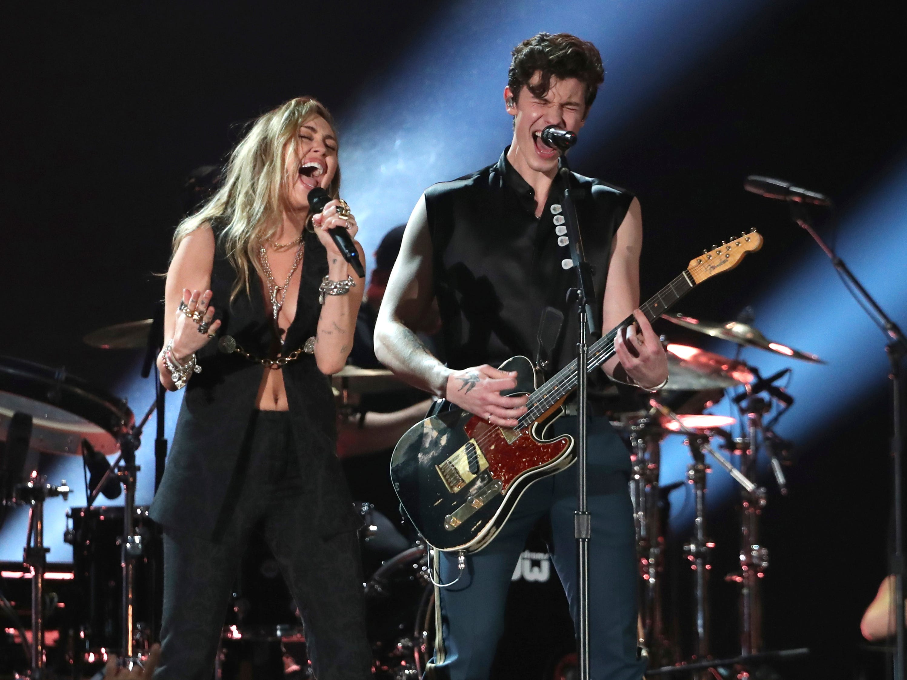 "Miley Cyrus, left, and Shawn Mendes perform ""In My Blood"" at the 61st annual Grammy Awards."