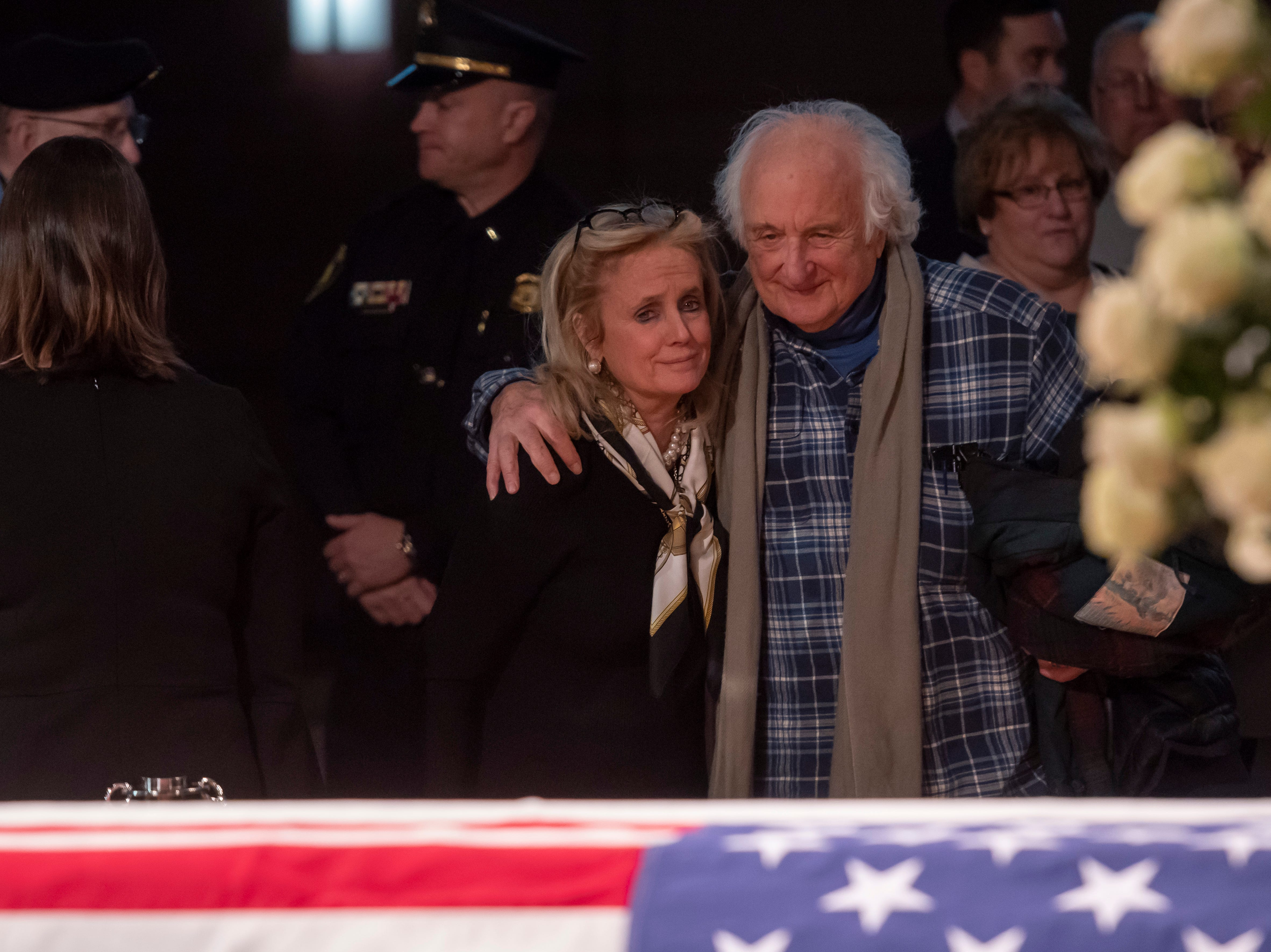 Debbie Dingell and former U.S. Rep. Sander Levin console each other during a visitation for former U.S. Rep. John Dingell.