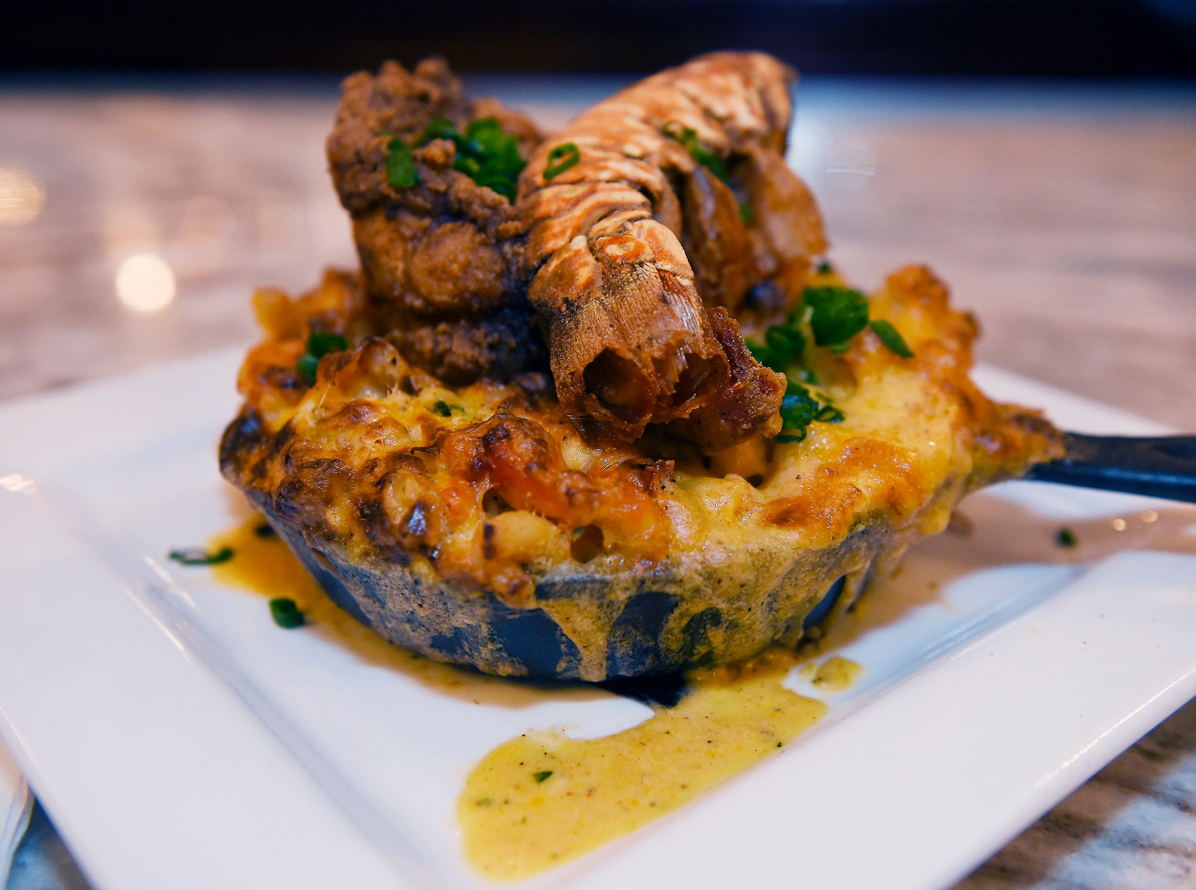 A plate of the Seafood Overload Mac & Cheese, (Cavatappi, five cheese blend, rock lobster tail and jumbo lump crab.