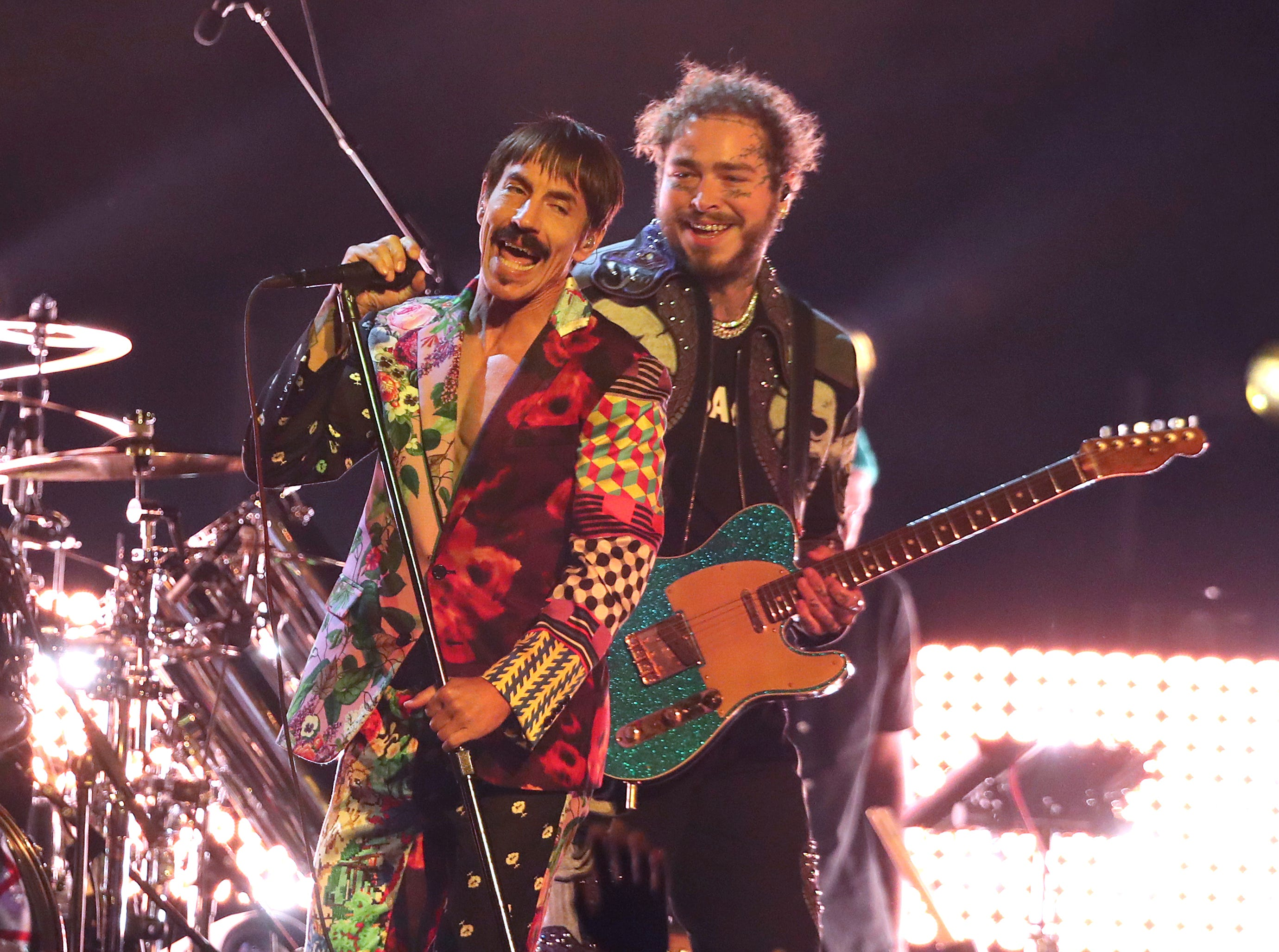 Anthony Kiedis, left, of Red Hot Chili Peppers, and Post Malone perform a medley at the 61st annual Grammy Awards.
