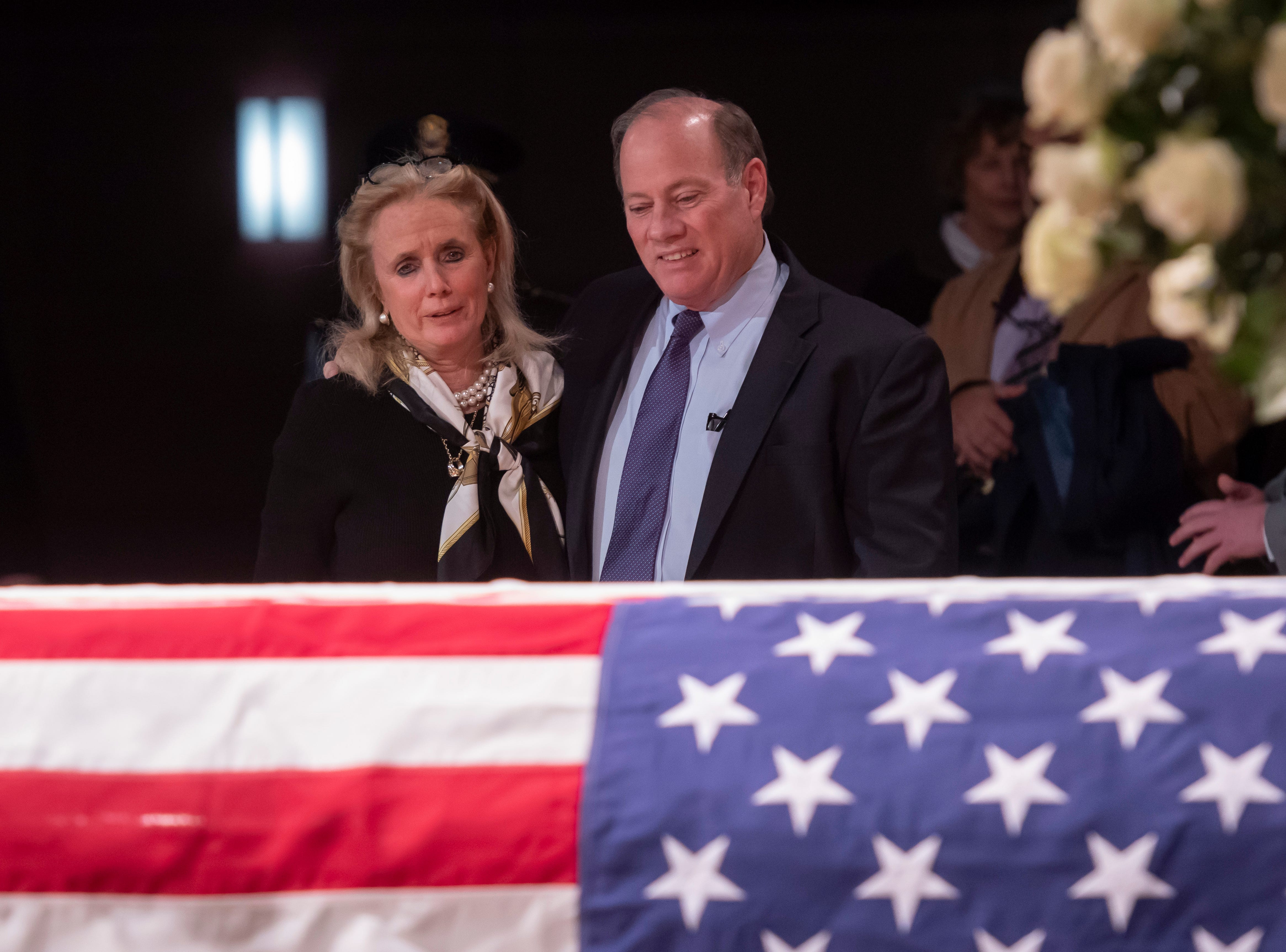 U.S. Rep. Debbie Dingell and Detroit Mayor Mike Duggan console each other during the visitation.