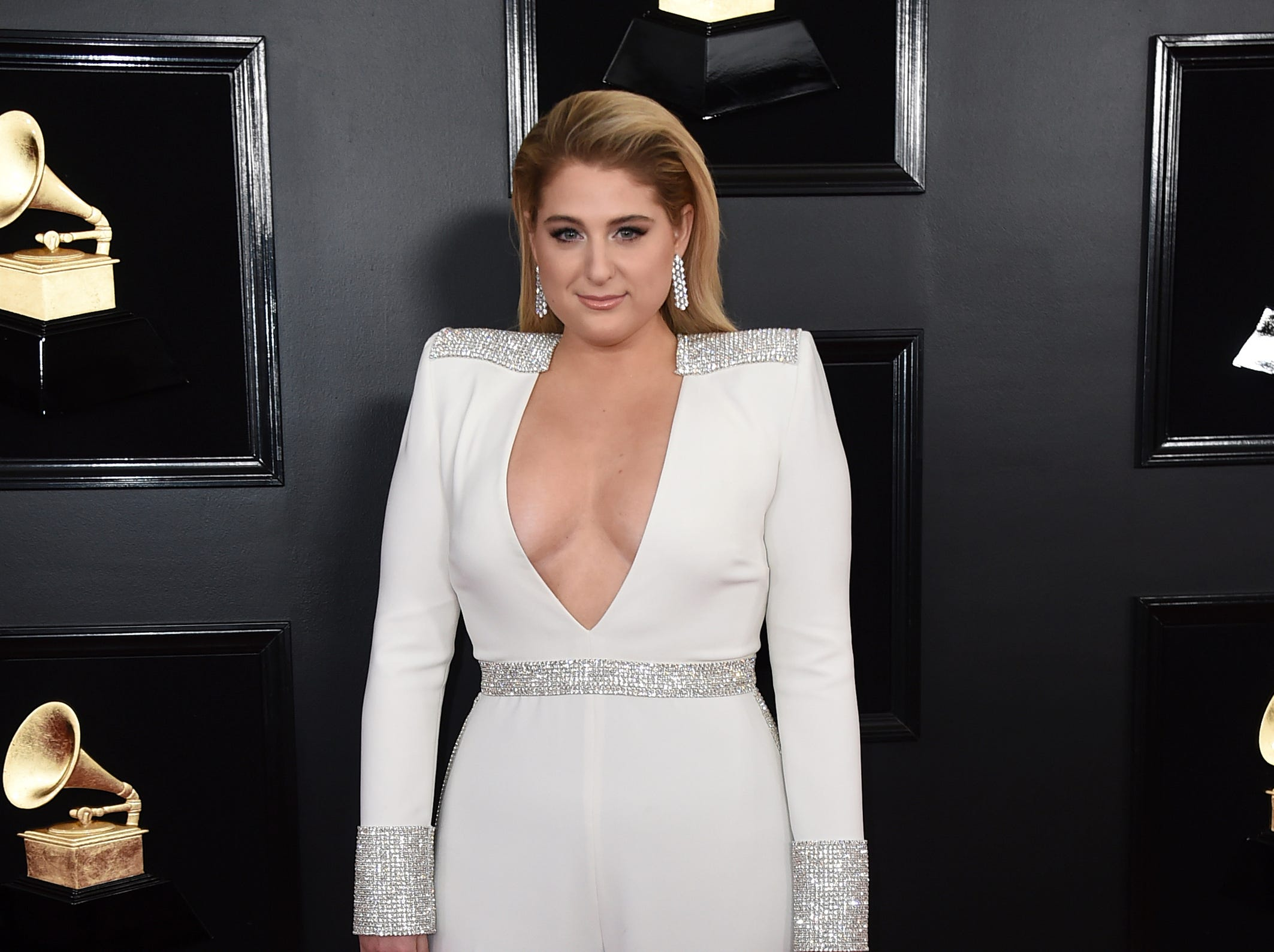 Meghan Trainor arrives at the 61st annual Grammy Awards.