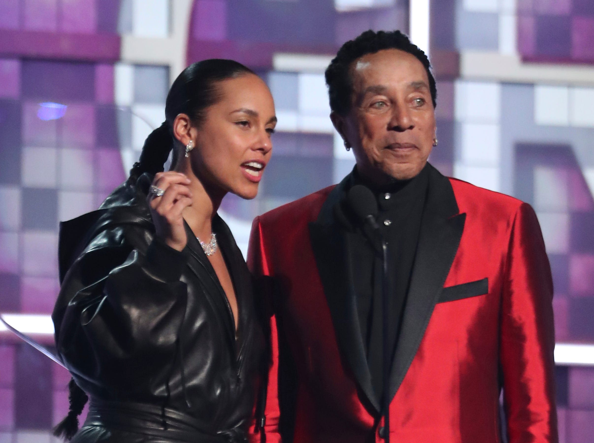 Alicia Keys, left, and Smokey Robinson introduce a tribute to Motown's 60th anniversary at the 61st annual Grammy Awards.