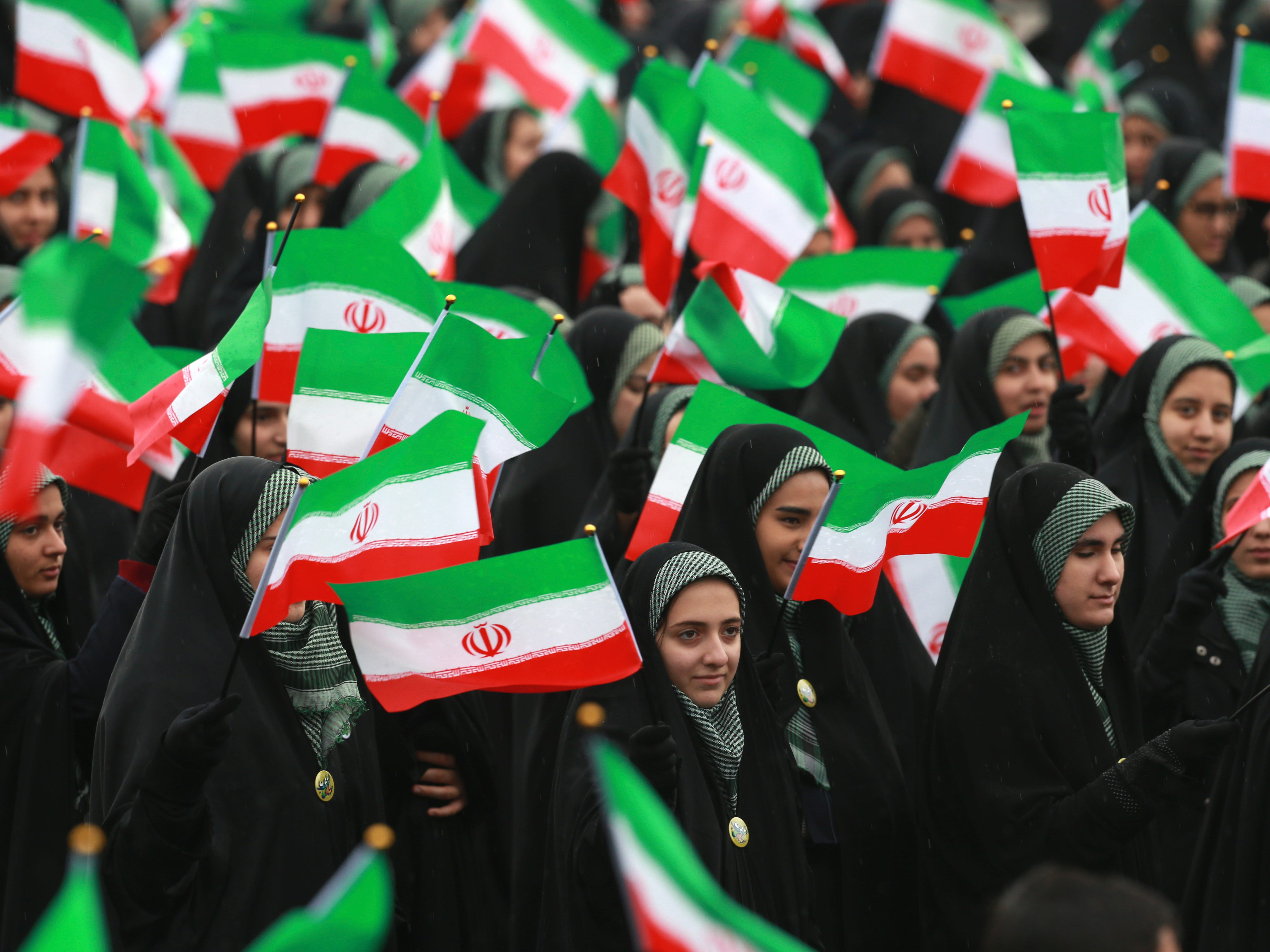 Iranians wave national flags during a ceremony celebrating the 40th anniversary of the Islamic Revolution, at the Azadi, or Freedom, Square, in Tehran on Monday, Feb. 11, 2019. On Feb. 11, 1979, Iran's military stood down after days of street battles, allowing the revolutionaries to sweep across the country, and the government of Shah Mohammad Reza Pahlavi resigned.