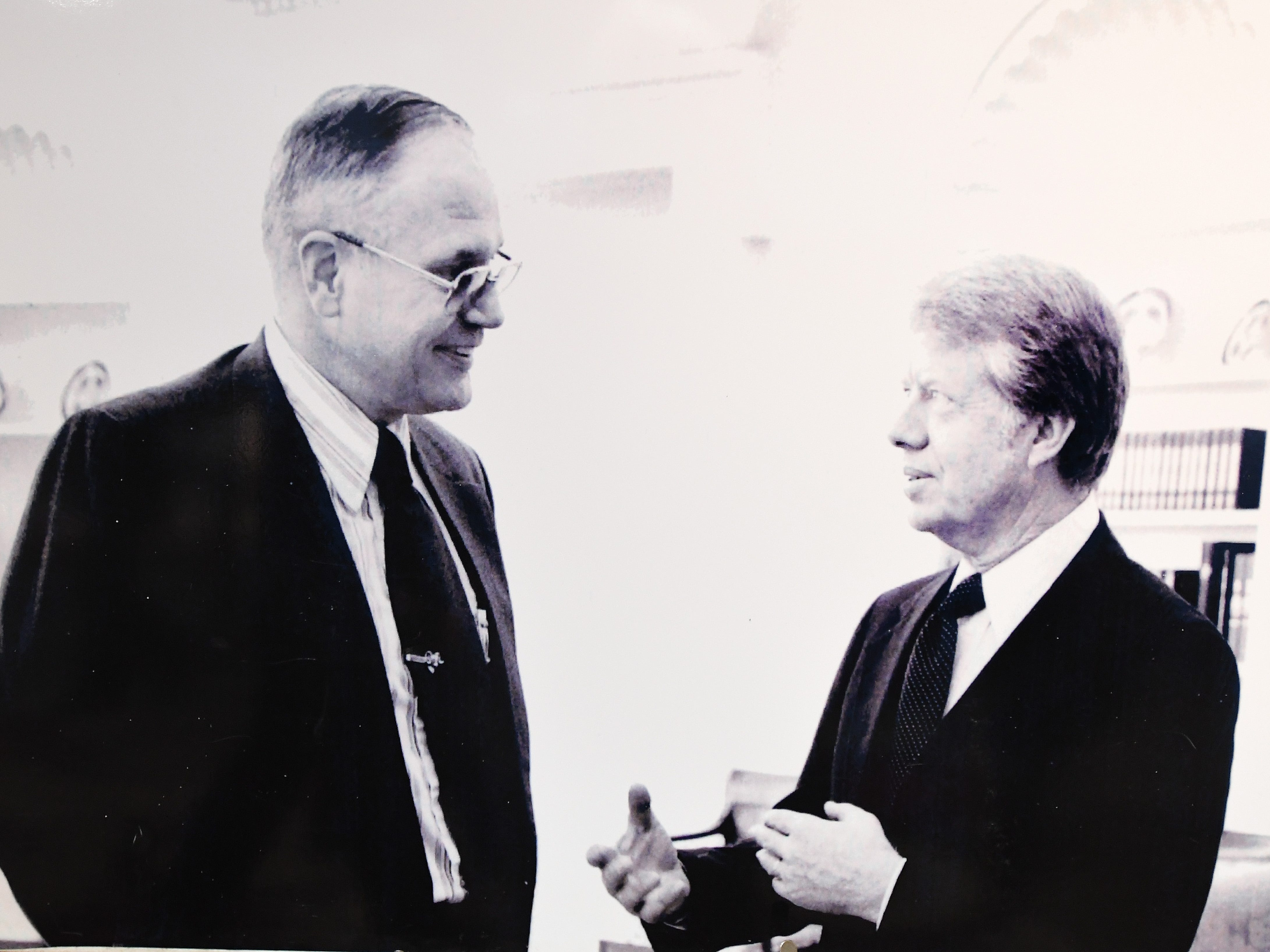 In the lobby of the Ford arts center,  photos of Rep. John D. Dingell during his career are displayed. Above, Dingell, left, talks with then-President Jimmy Carter.