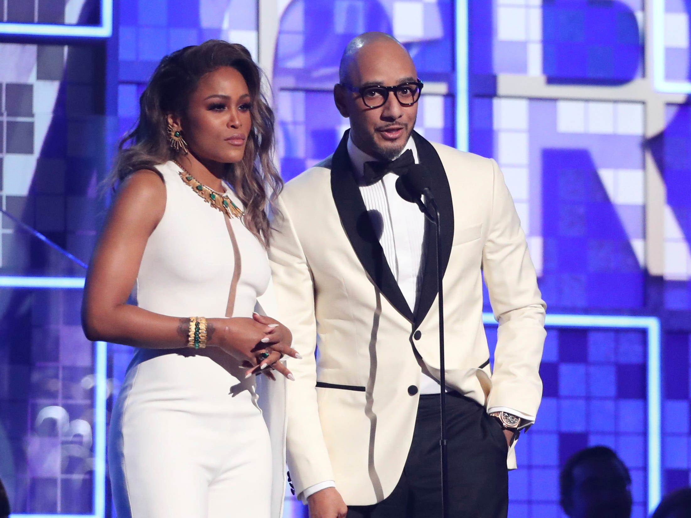 Eve, left, and Swizz Beatz introduce a performance by Travis Scott at the 61st annual Grammy Awards.