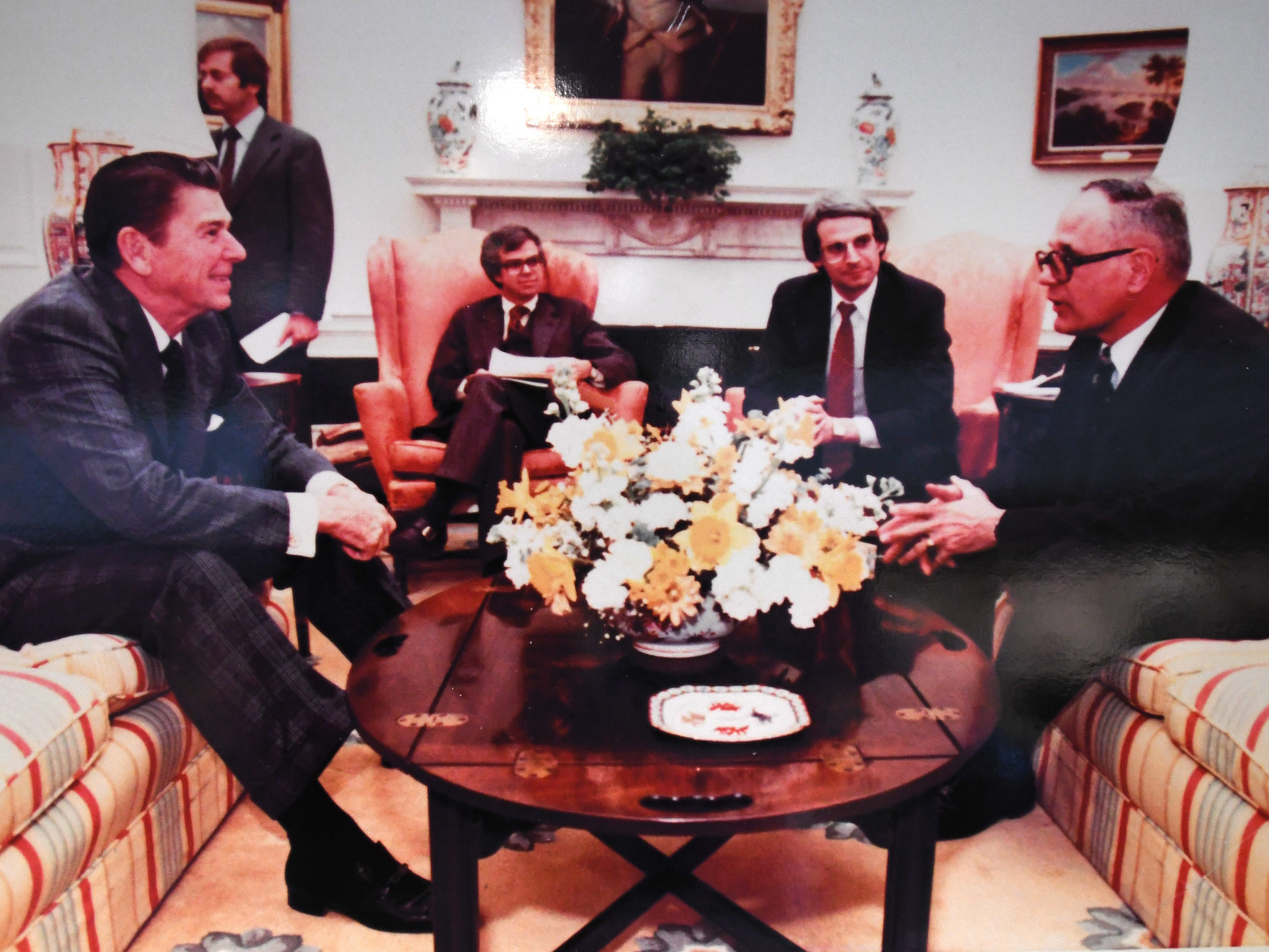 President Ronald Reagan chats with Dingell in the White House.