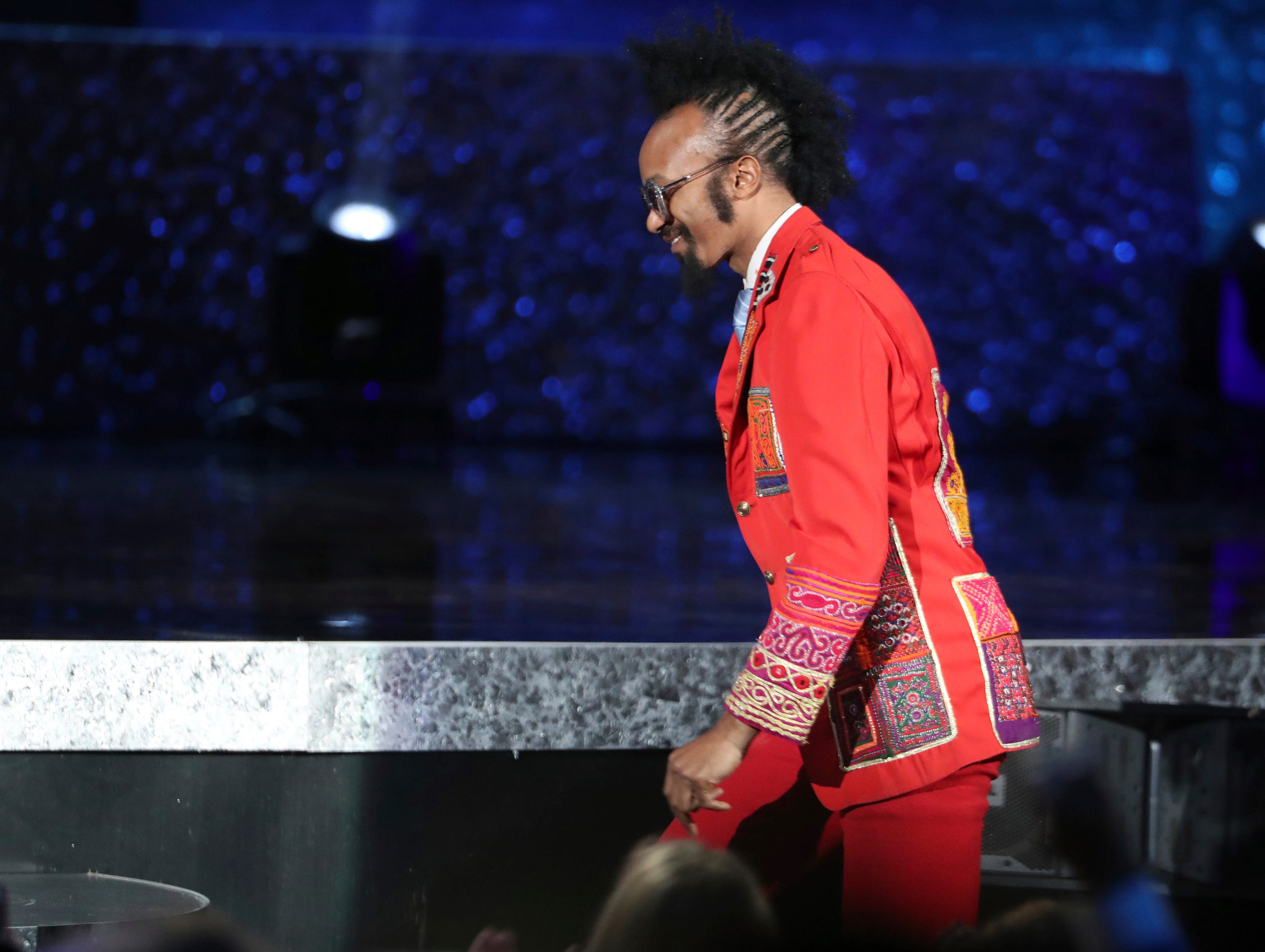 "Fantastic Negrito walks on stage to accept the award for best contemporary blues album for ""Please Don't Be Dead"" at the 61st annual Grammy Awards."