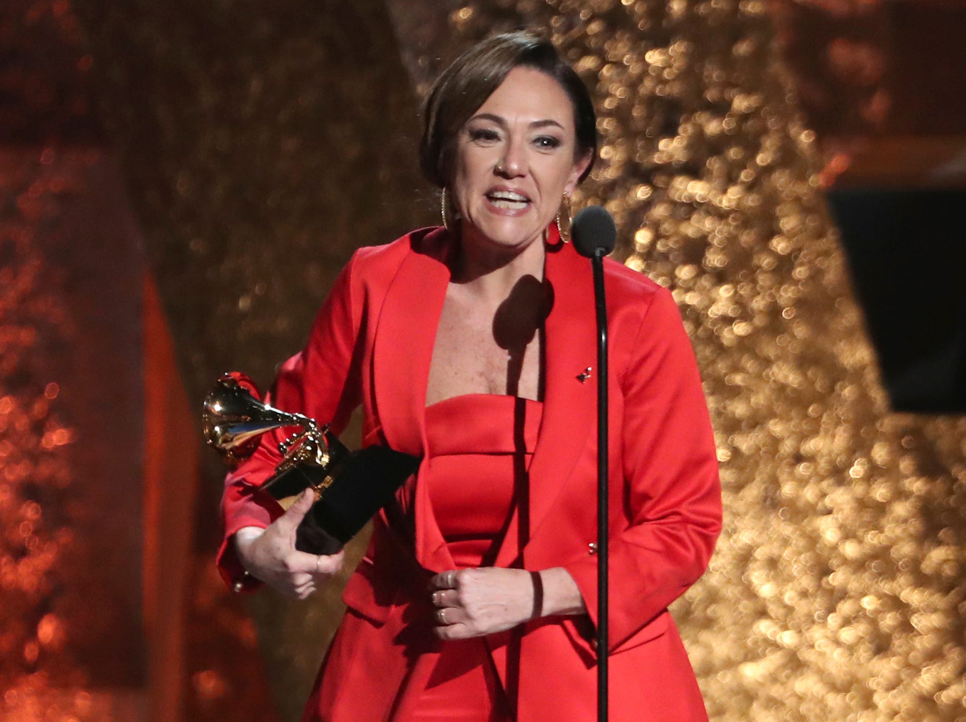 "Claudia Brant accepts the award for best Latin pop album for ""Sincera"" at the 61st annual Grammy Awards."