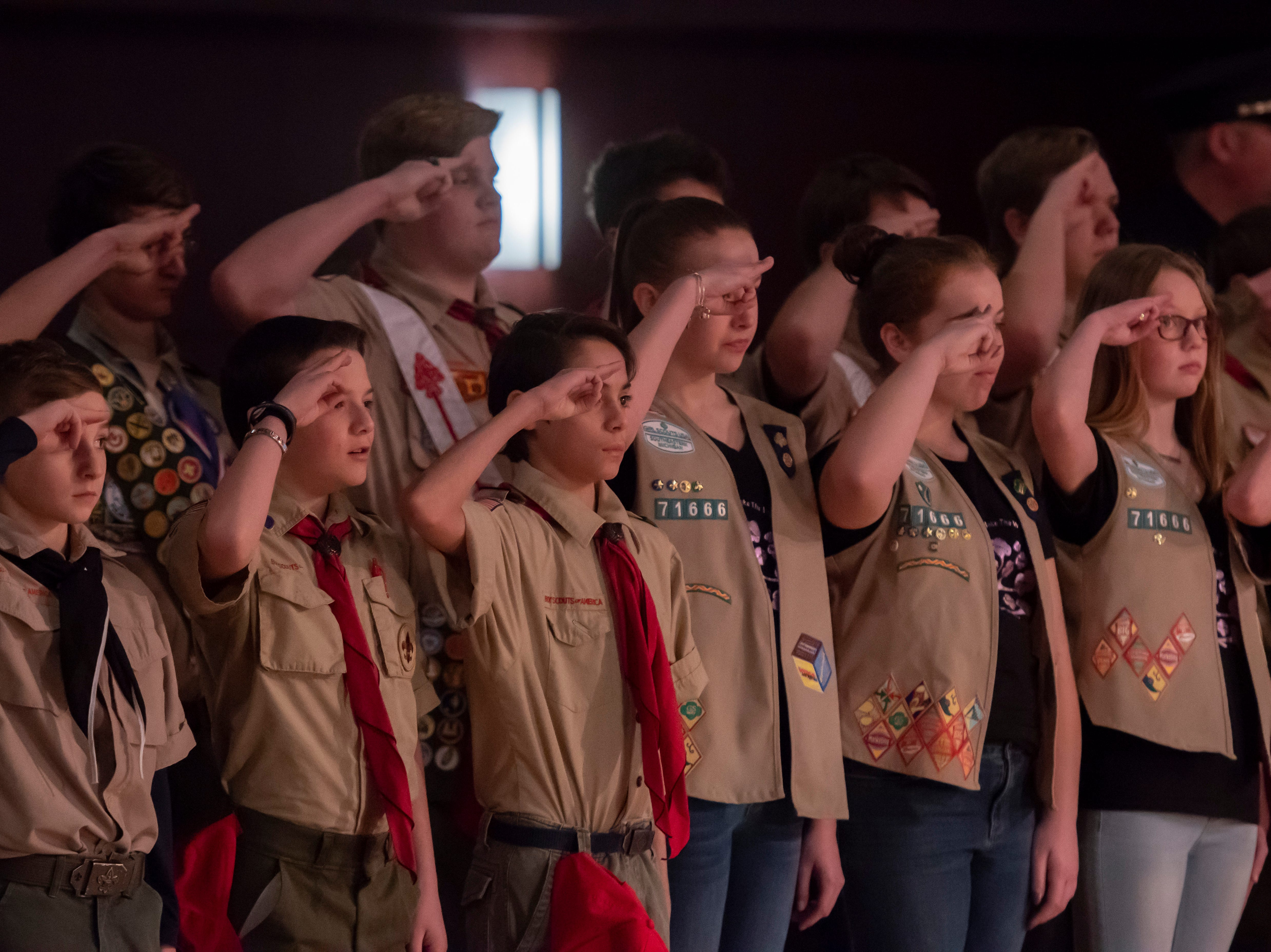 Boy and Girl Scouts salute during a visitation for former U.S. Rep. John Dingell.