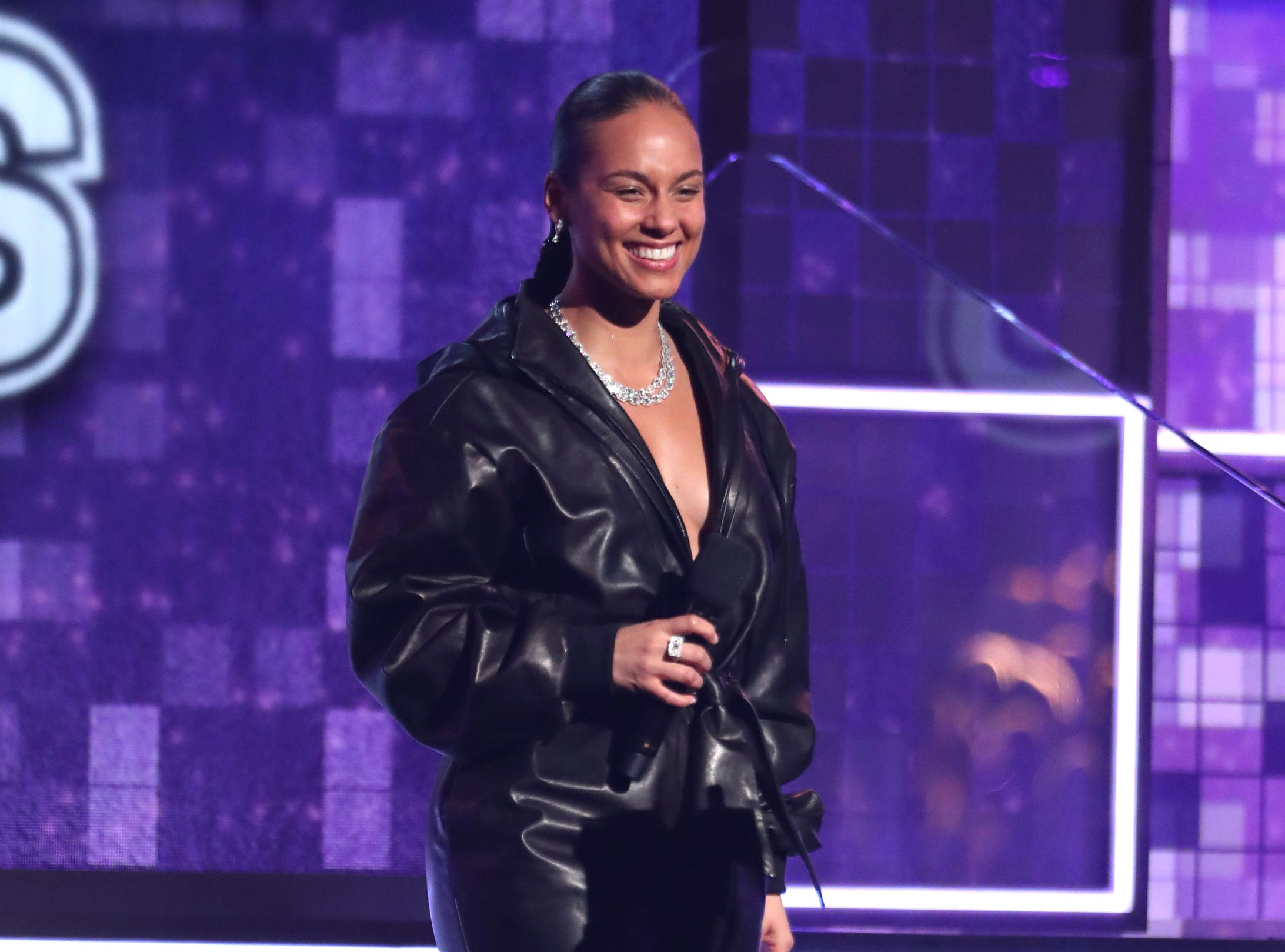 Host Alicia Keys speaks at the 61st annual Grammy Awards.