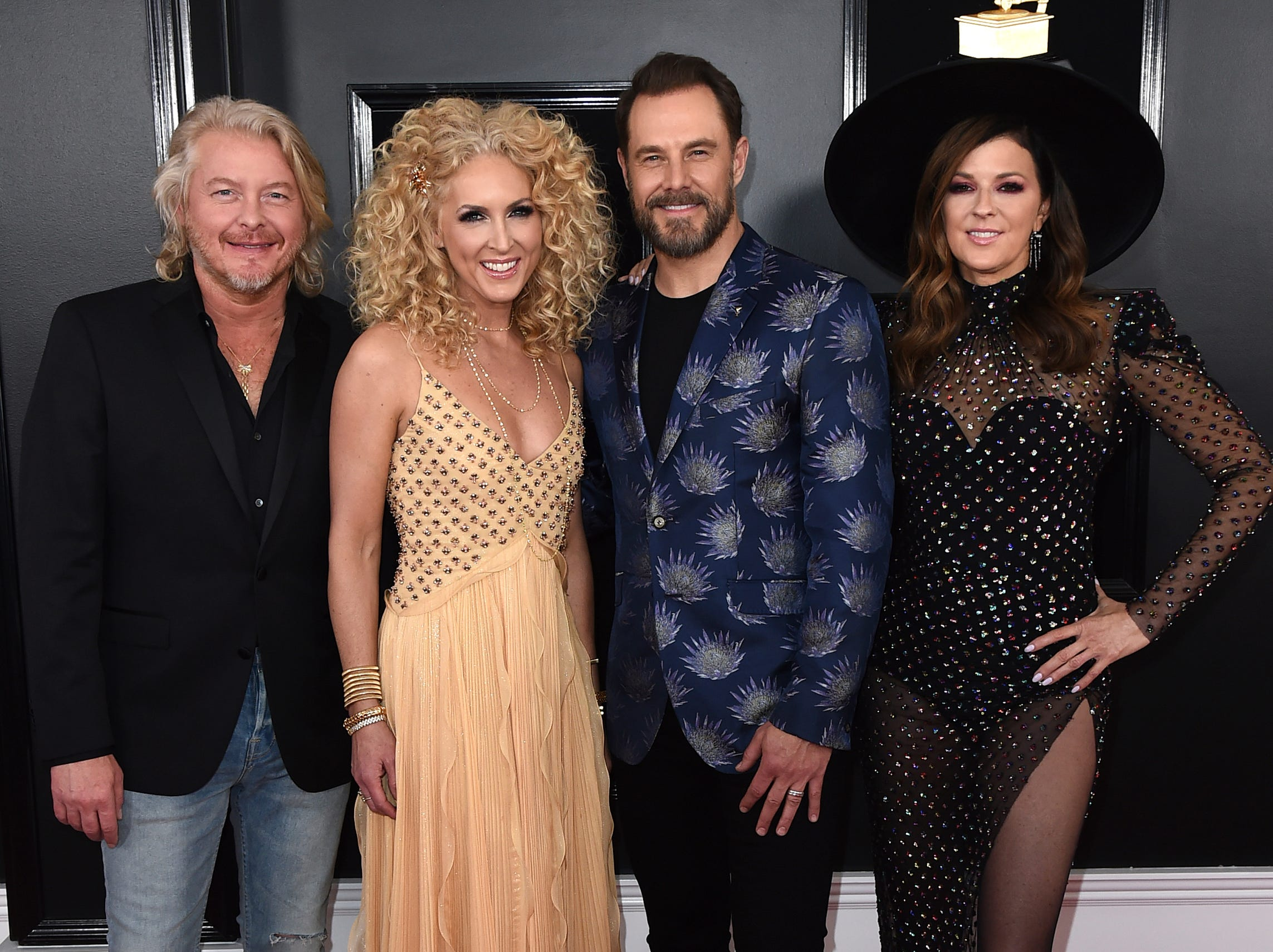 Philip Sweet, from left, Kimberly Schlapman, Jimi Westbrook, and Karen Fairchild of Little Big Town arrive at the 61st annual Grammy Awards.