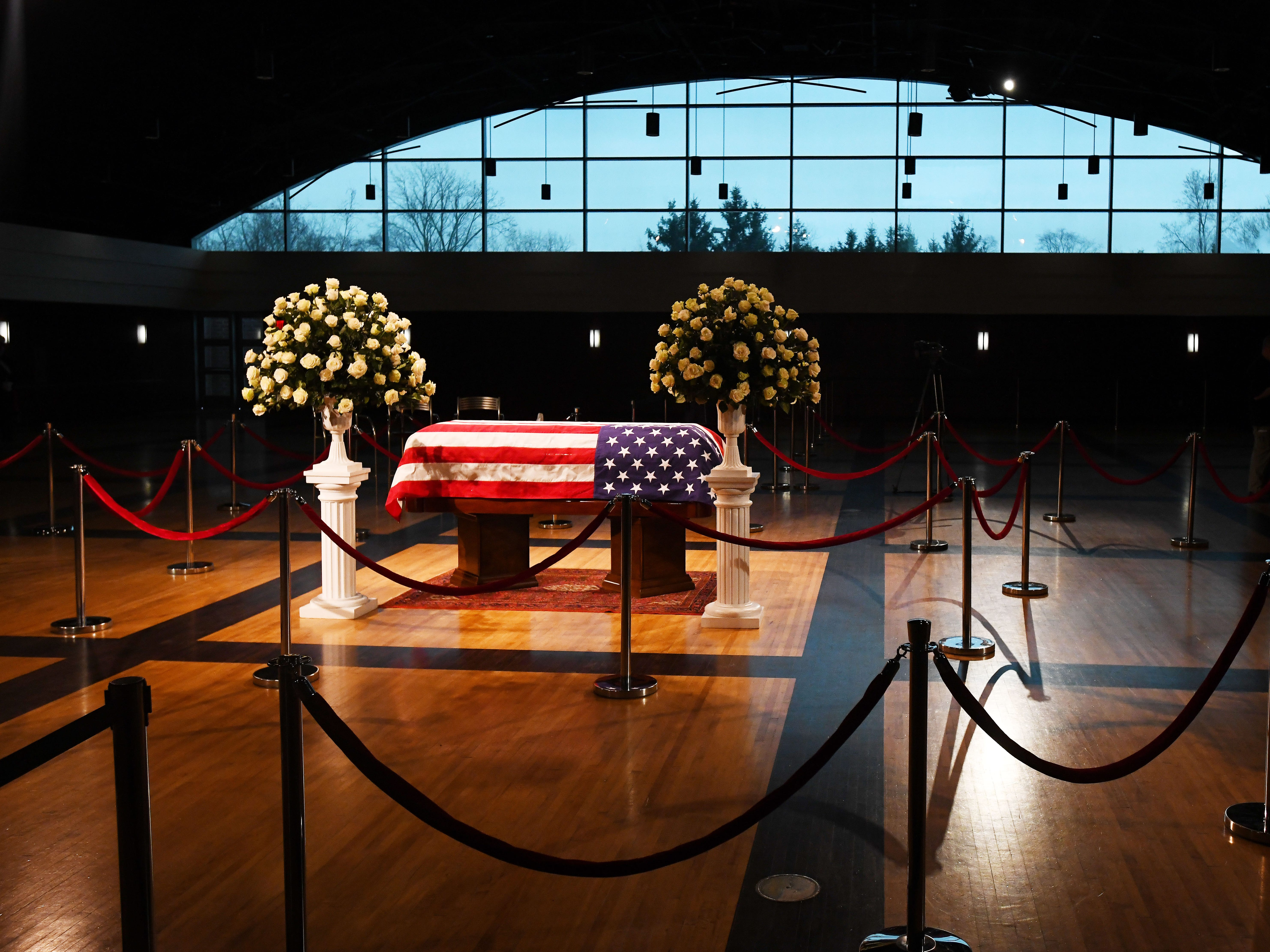 The casket sits in the middle of a large banquet room at the Ford Community and Performing Arts Center.