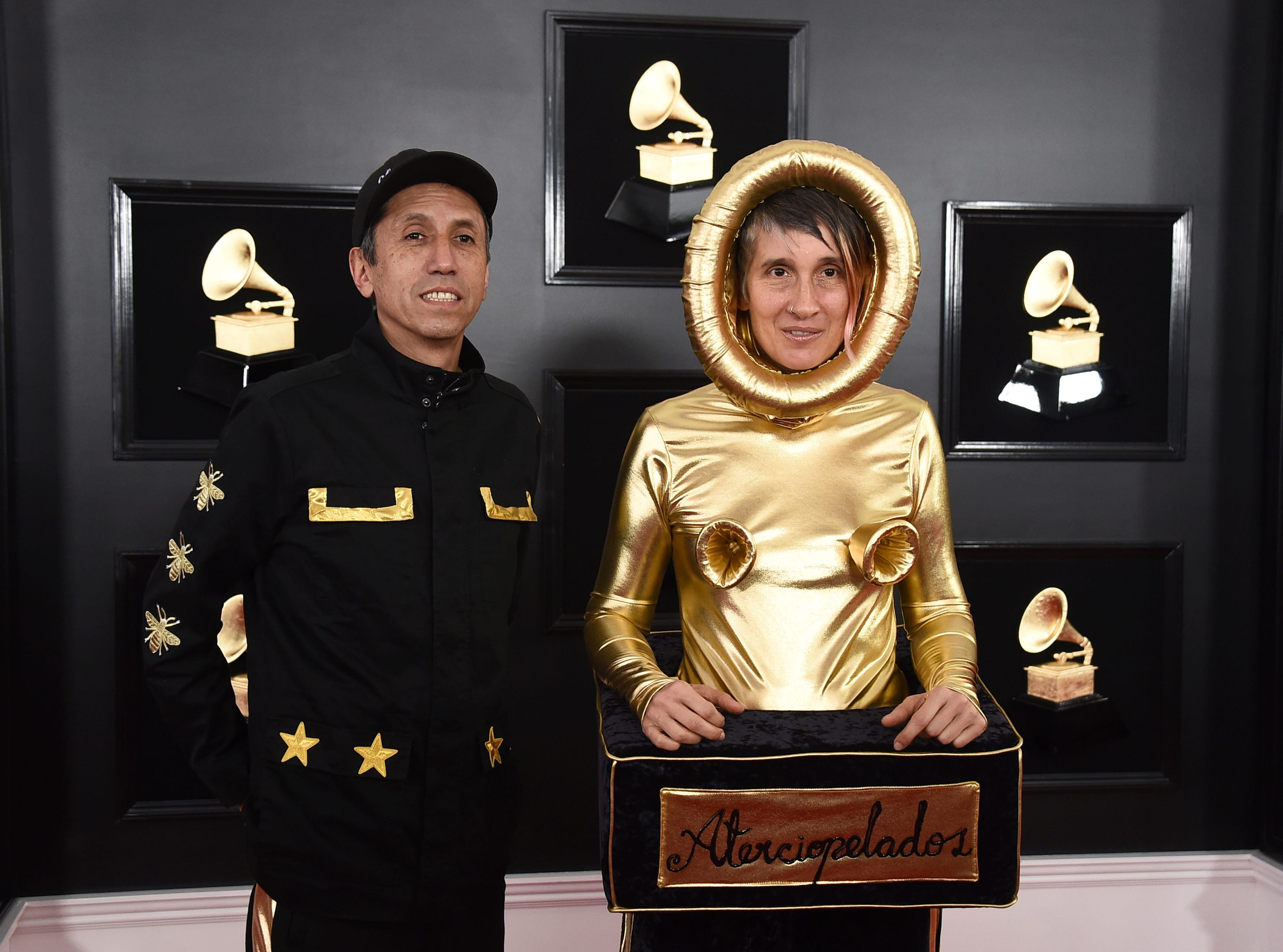 Hector Buitrago, left, and Andrea Echeverri, of Aterciopelados, arrive at the 61st annual Grammy Awards at the Staples Center on Sunday, Feb. 10, 2019, in Los Angeles. .