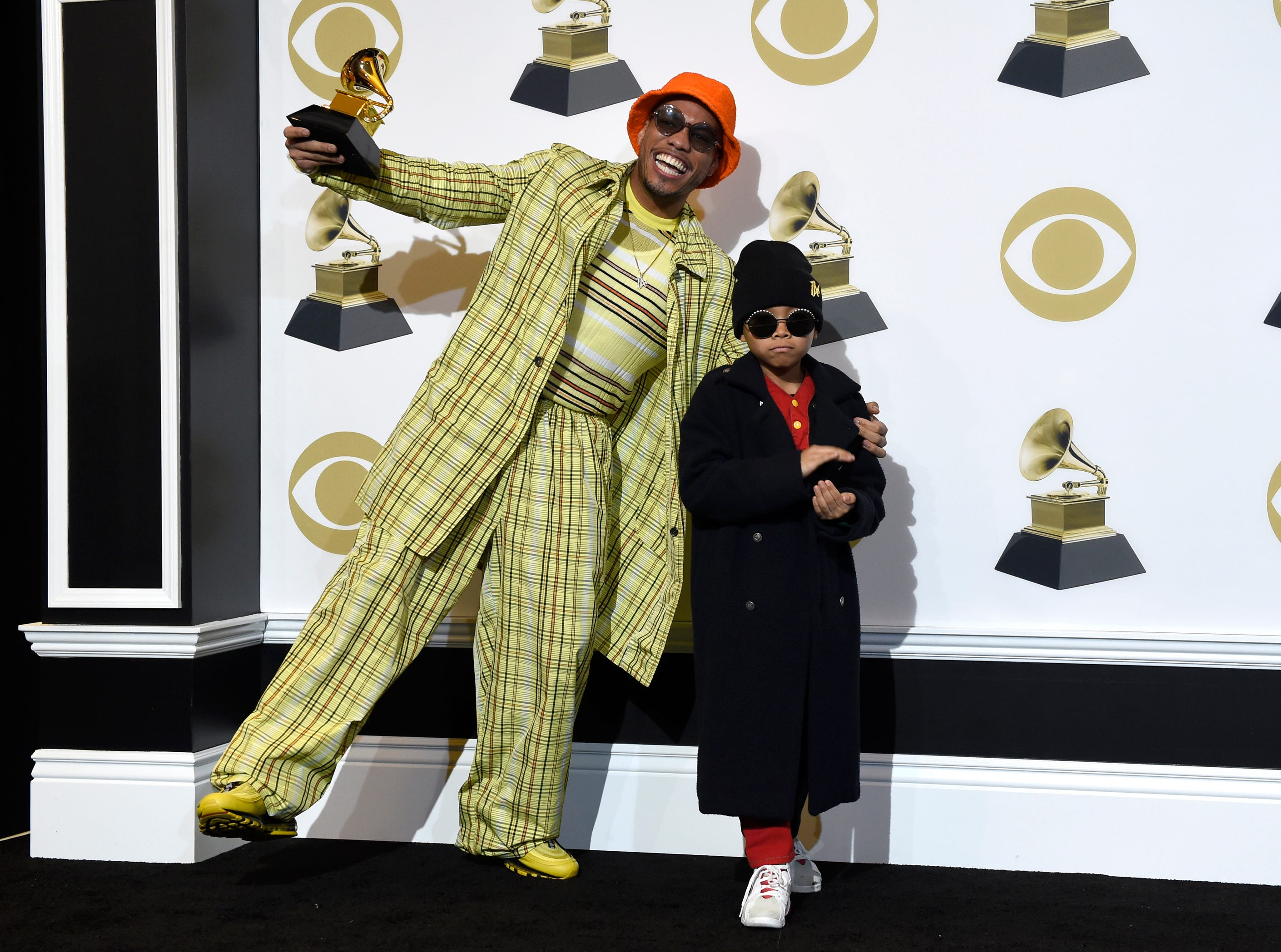 "Anderson .Paak, left, winner of the award for best rap performance for ""Bubblin"" poses in the press room with son Soul Rasheed at the 61st annual Grammy Awards."