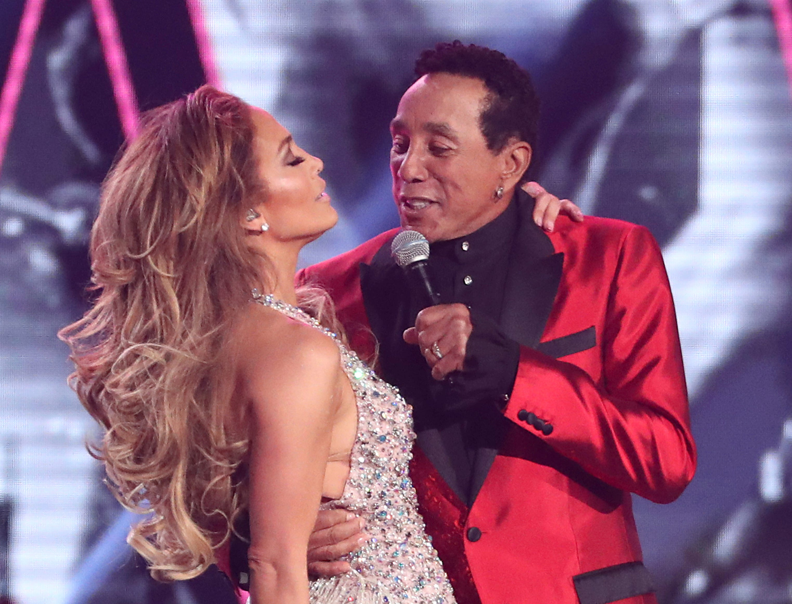 Jennifer Lopez, left, and Smokey Robinson perform a medley during a tribute to Motown's 60th anniversary at the 61st annual Grammy Awards.