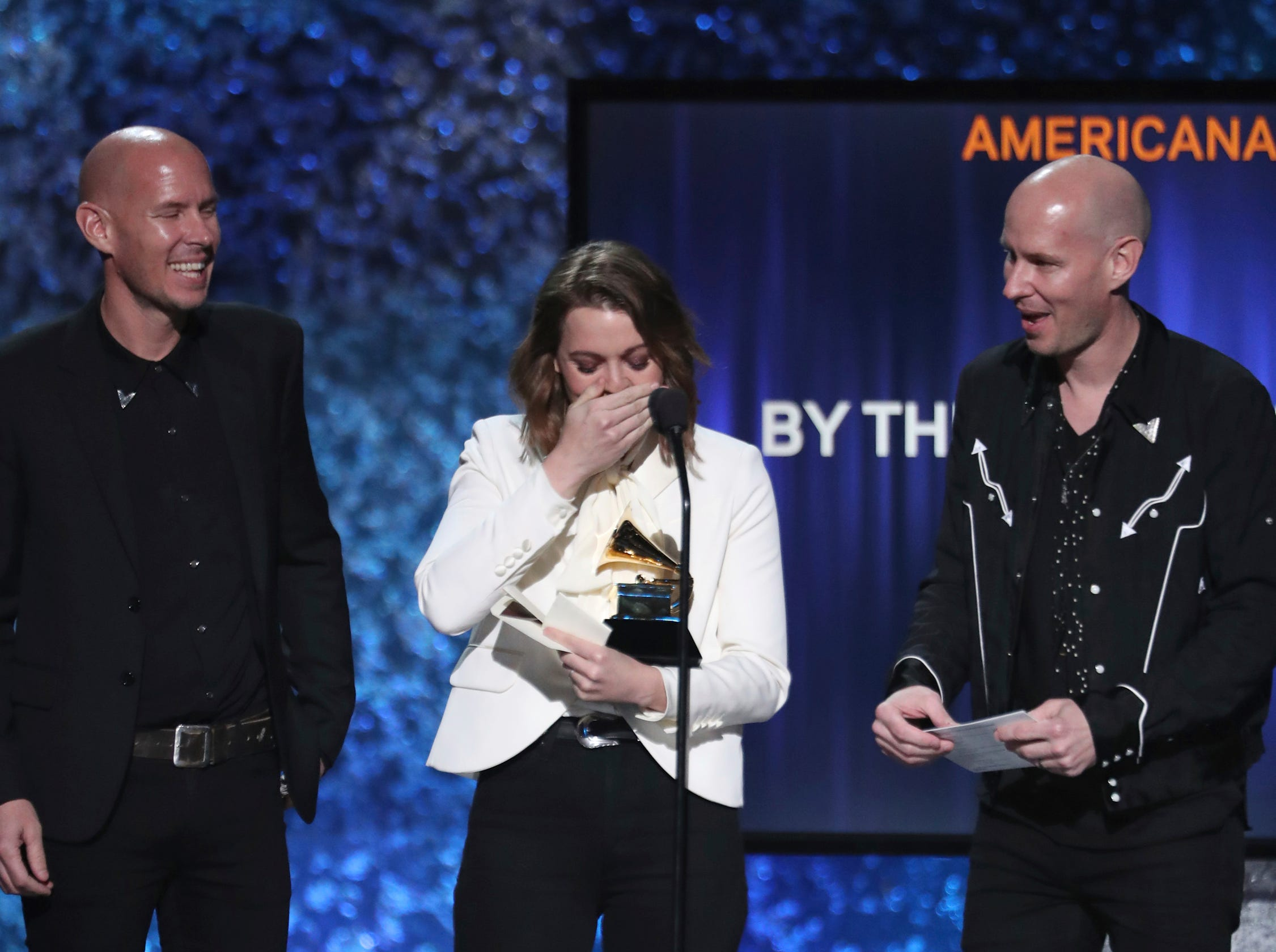 "Phil Hanseroth, from left, Brandi Carlile and Tim Hanseroth accept the award for best Americana album for ""By the Way, I Forgive You"" at the 61st annual Grammy Awards."
