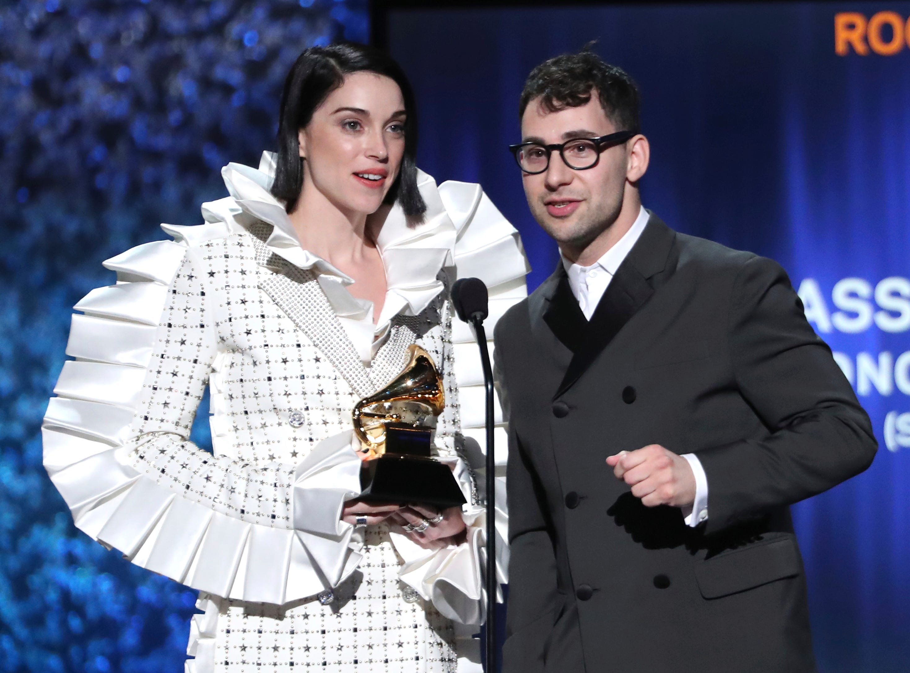 "Annie Clark, also known as St. Vincent, left, and Jack Antonoff accept the award for best rock song for ""Masseduction"" at the 61st annual Grammy Awards."