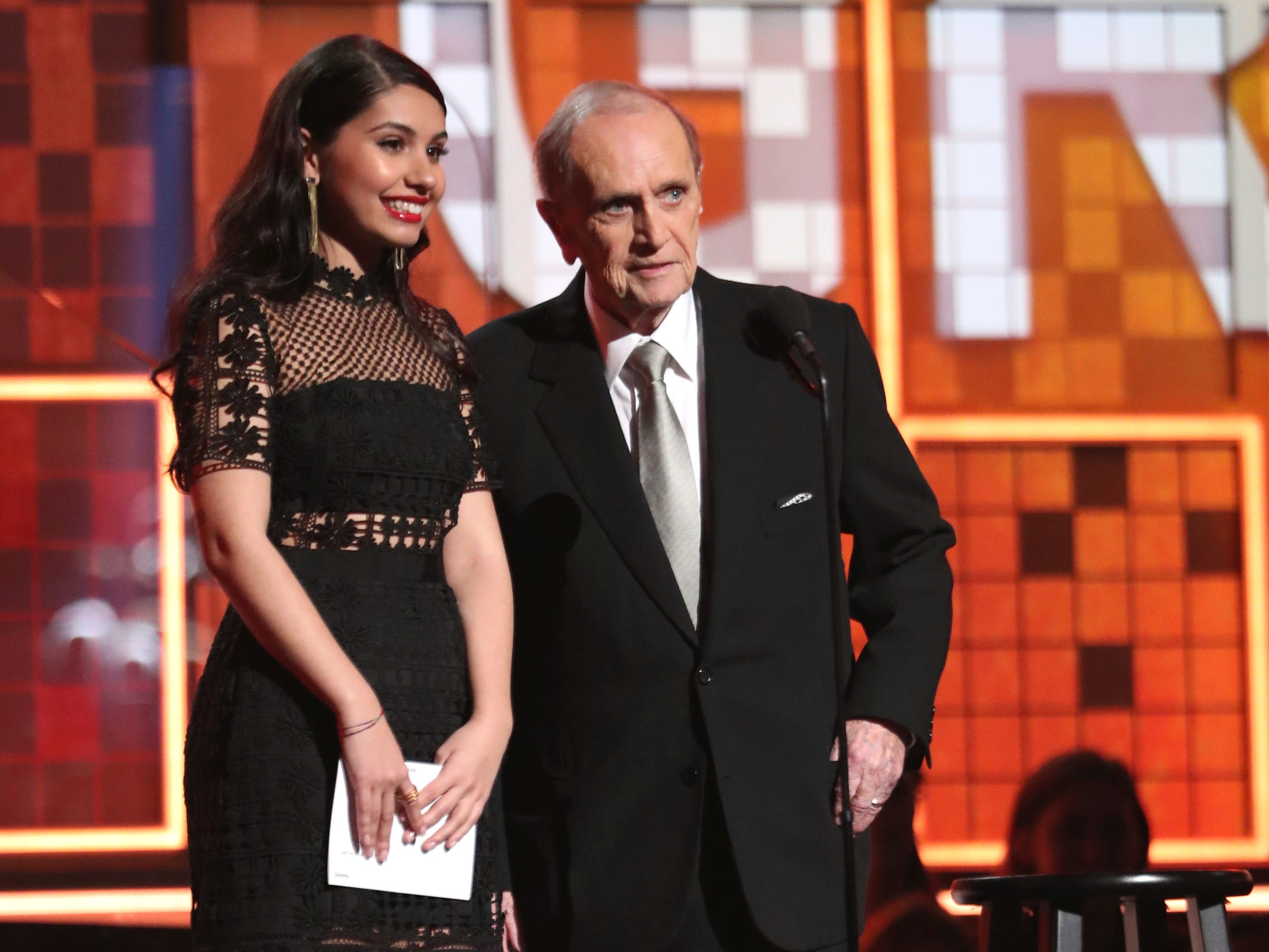 Alessia Cara, left, and Bob Newhart present the award for best new artist at the 61st annual Grammy Awards.